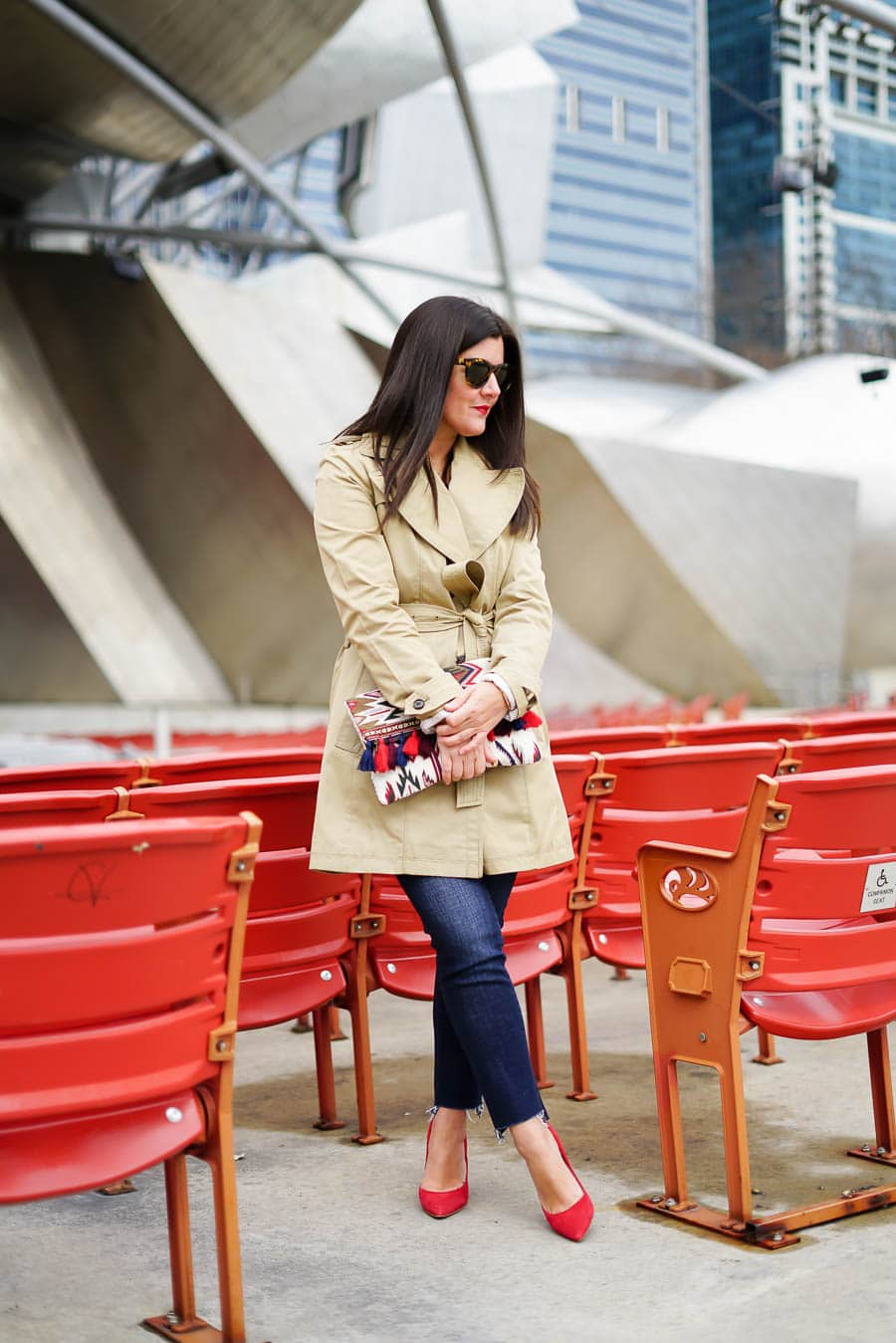 A Lily Love Affair shares how to wear a trench coat for Fall with jeans and red heels