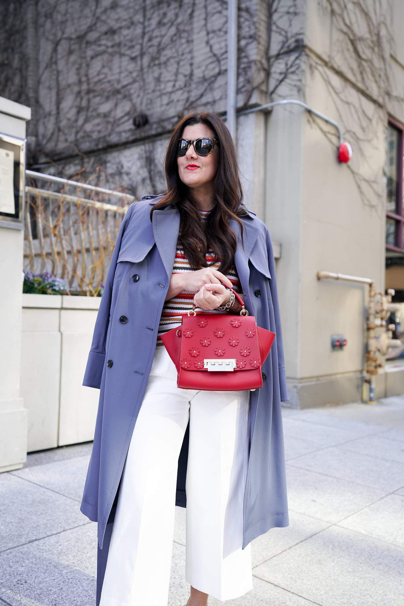 A petite women sharing how to wear a trench coat with white pants
