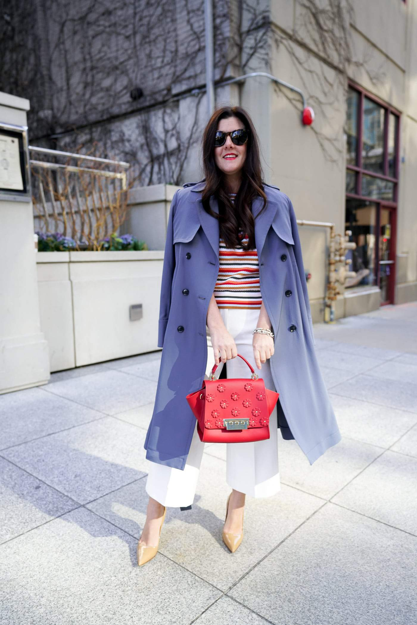 A petite women sharing how to wear a trench coat with pants