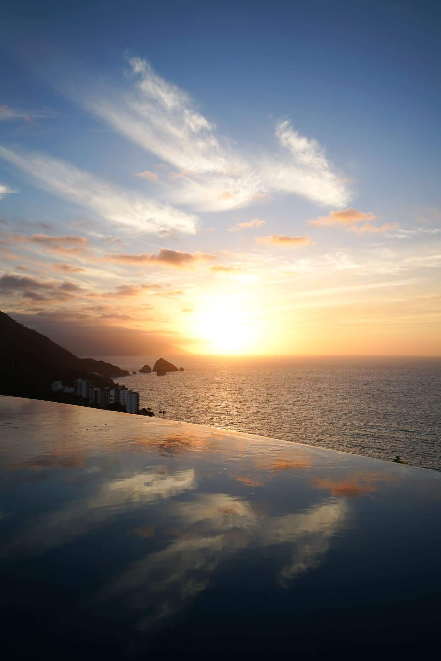 A Lily Love Affair shares a photo of a sunset from the Hotel Mousai roof top pool