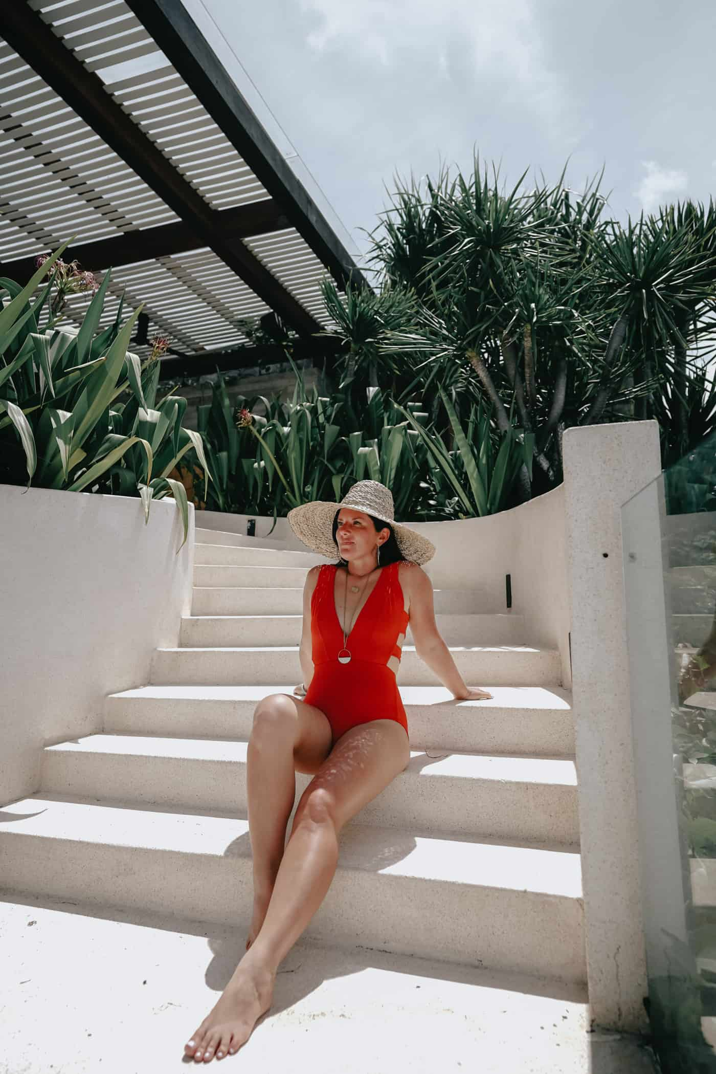 A Lily Love Affair wearing an all red one piece swimsuit in Bali