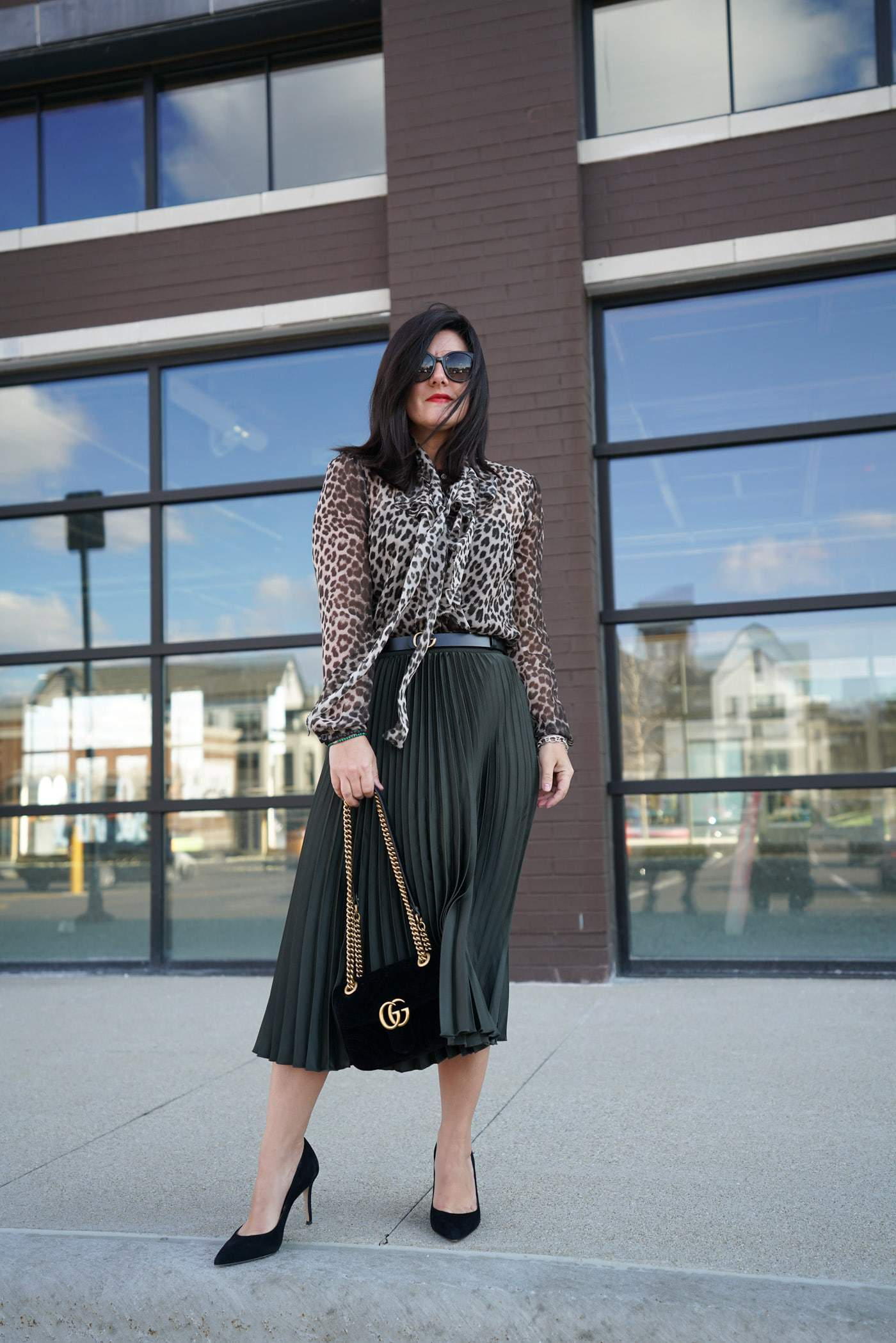 A pleated midi skirt is a gorgeous, versatile piece to add to your wardrobe this season. See how we styled this skirt for the office and beyond. Plus, 5 affordable pleated skirts perfect for updating your Spring Style.