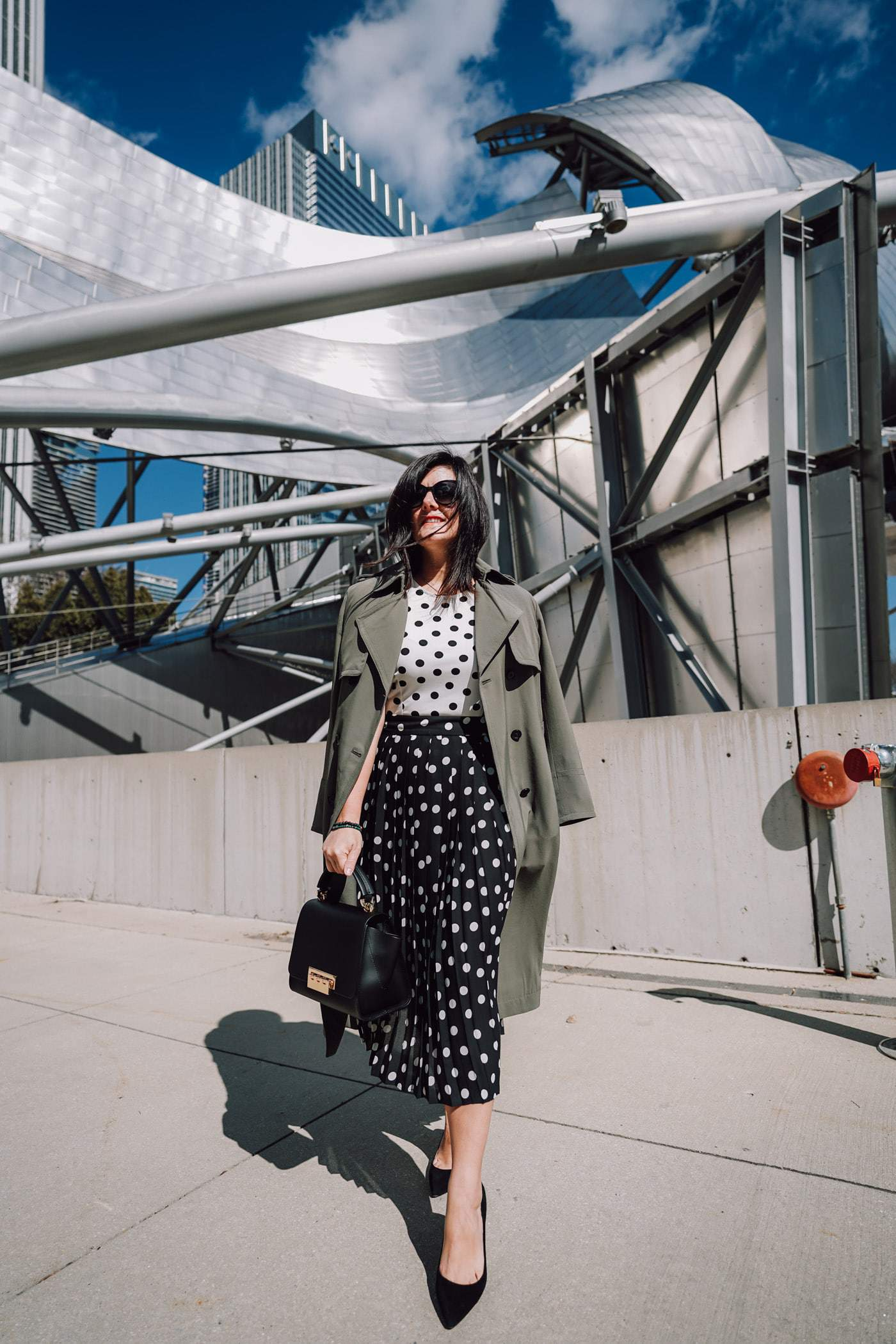 A petite women sharing how to wear a trench coat with a dress and heels