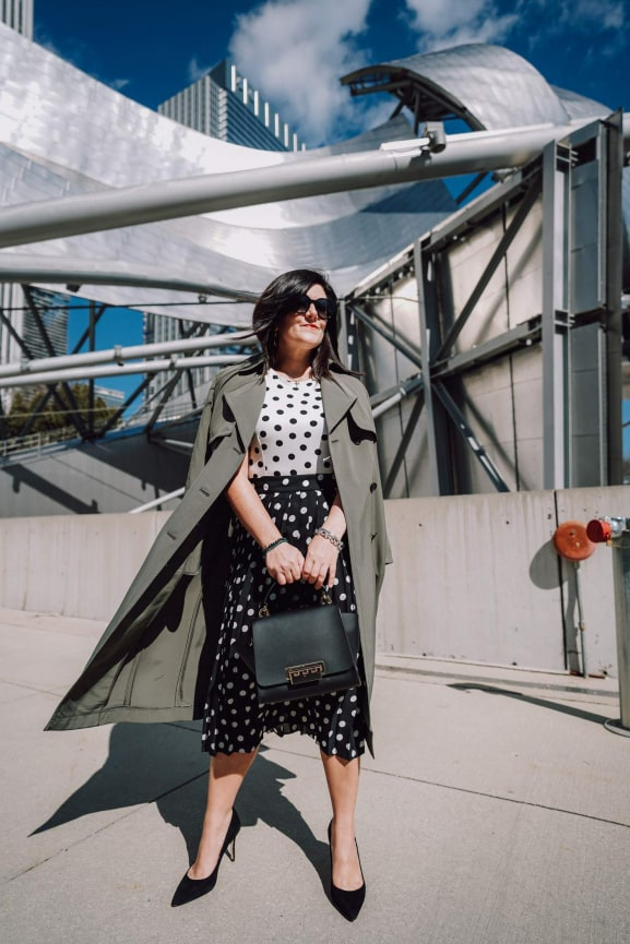A petite women sharing how to wear a trench green coat with a dress