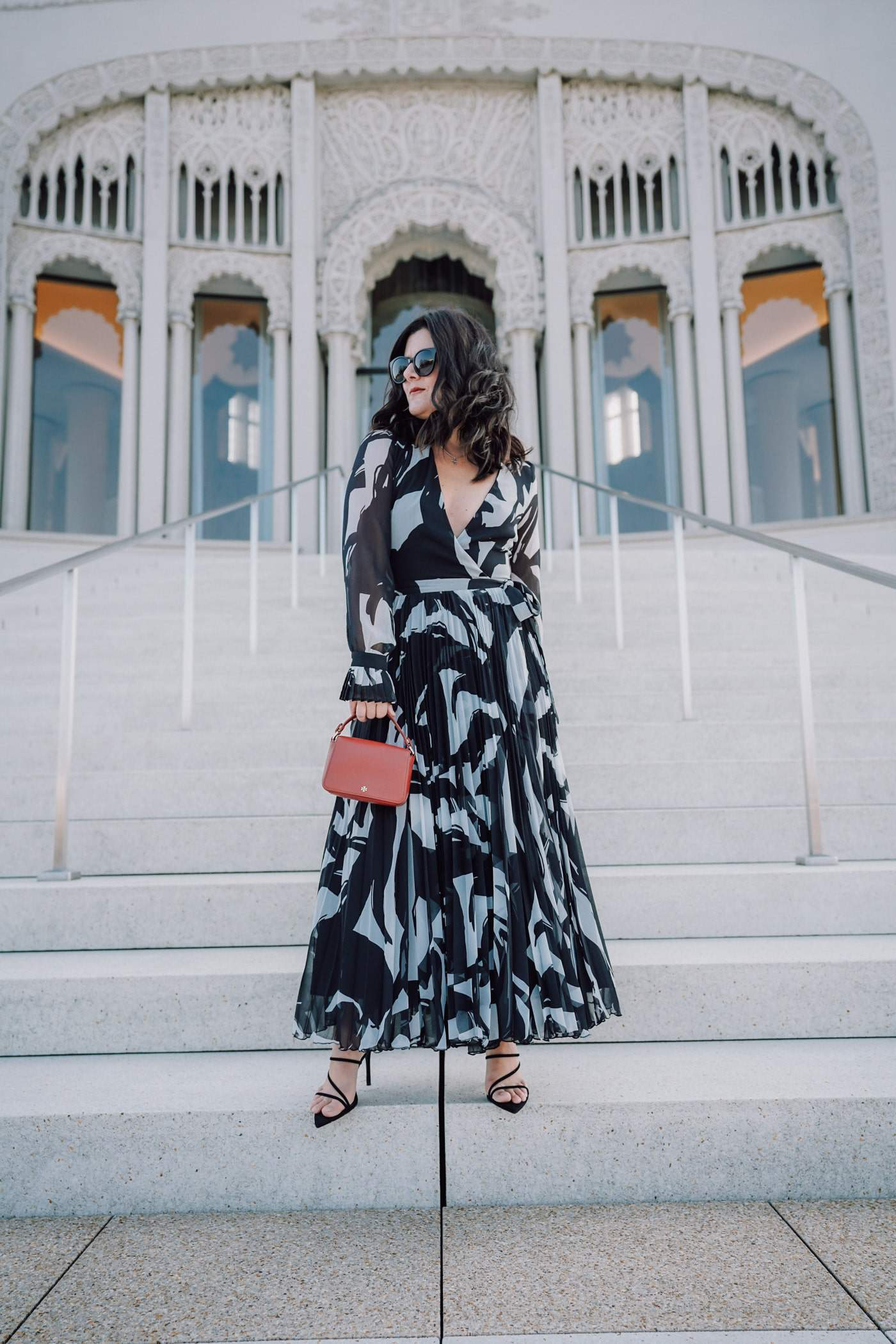 Anna of A Lily Love Affair shares this seasons best Summer wedding guest dresses all under $100. There are over 30 wedding guest dresses included in the round-up. Don't miss these beautiful wedding dresses for every budget. Includes this affordable H&M maxi dress and Mango heels.