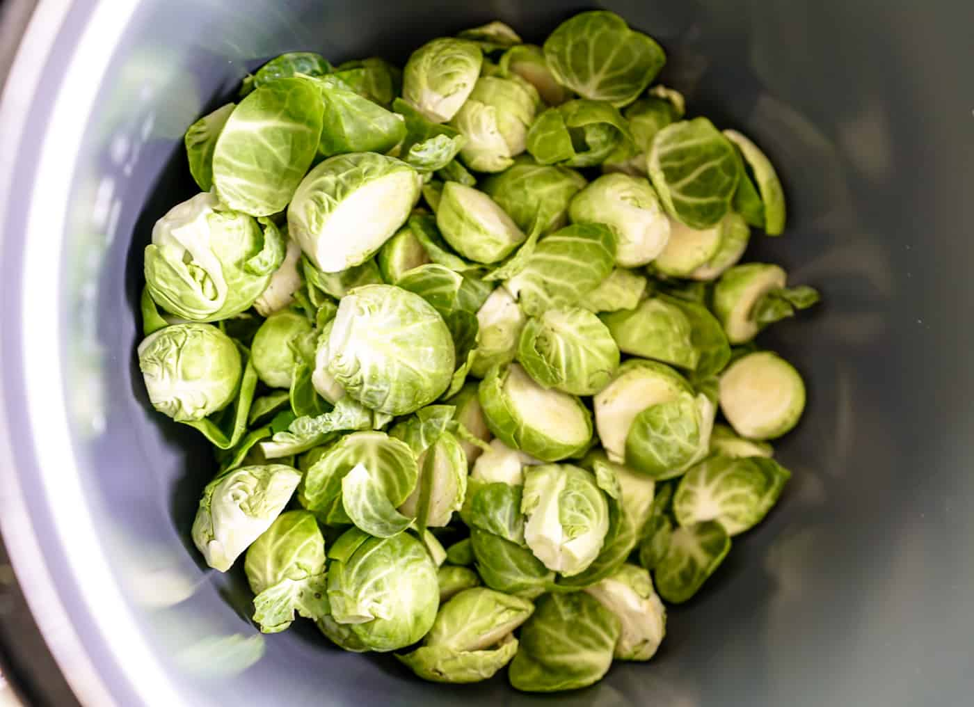 Fresh brussel sprouts cooking in the Instant Pot