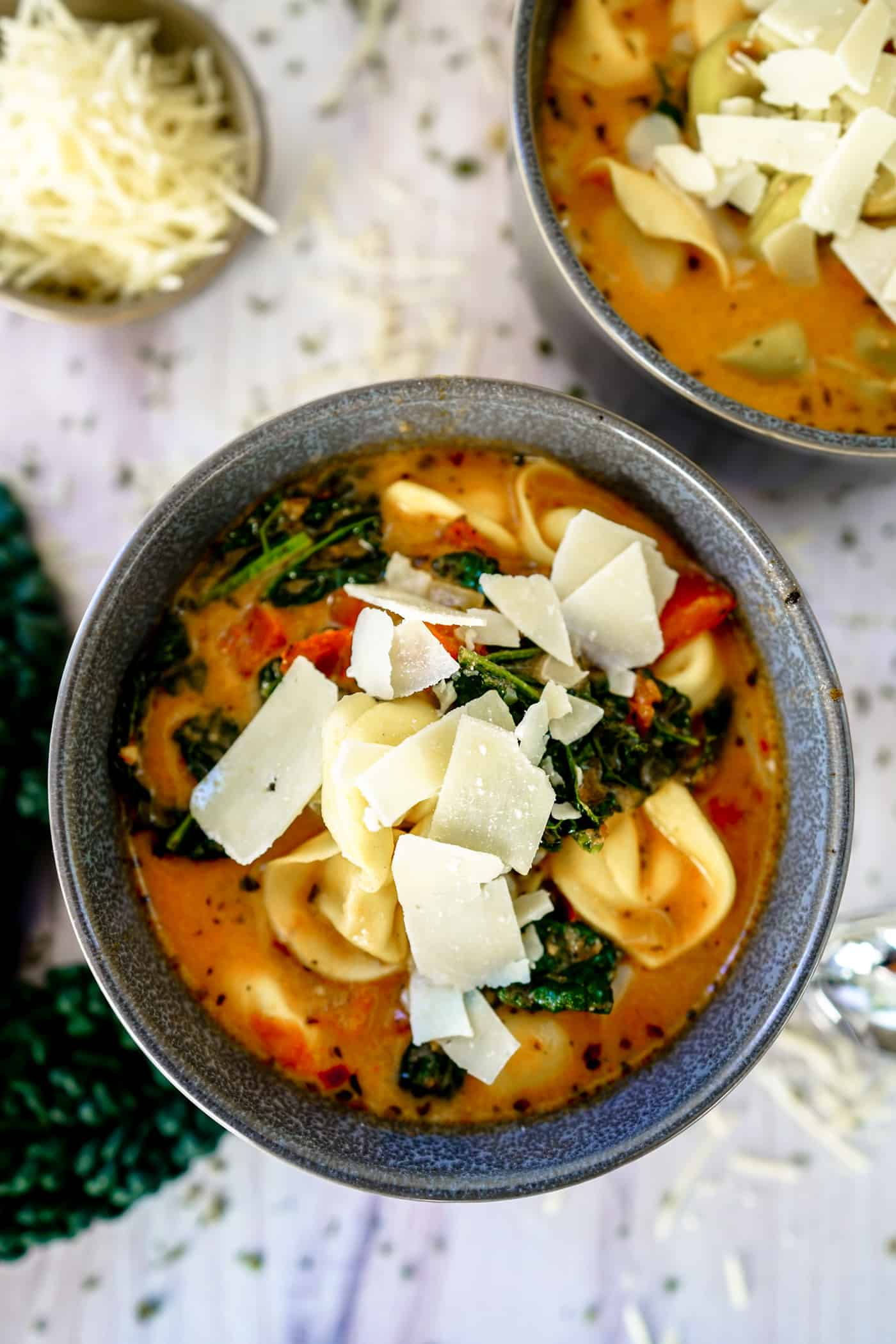 A Lily Love Affair shares a delicious Instant Pot Tortellini Soup recipe topped with parmesan cheese