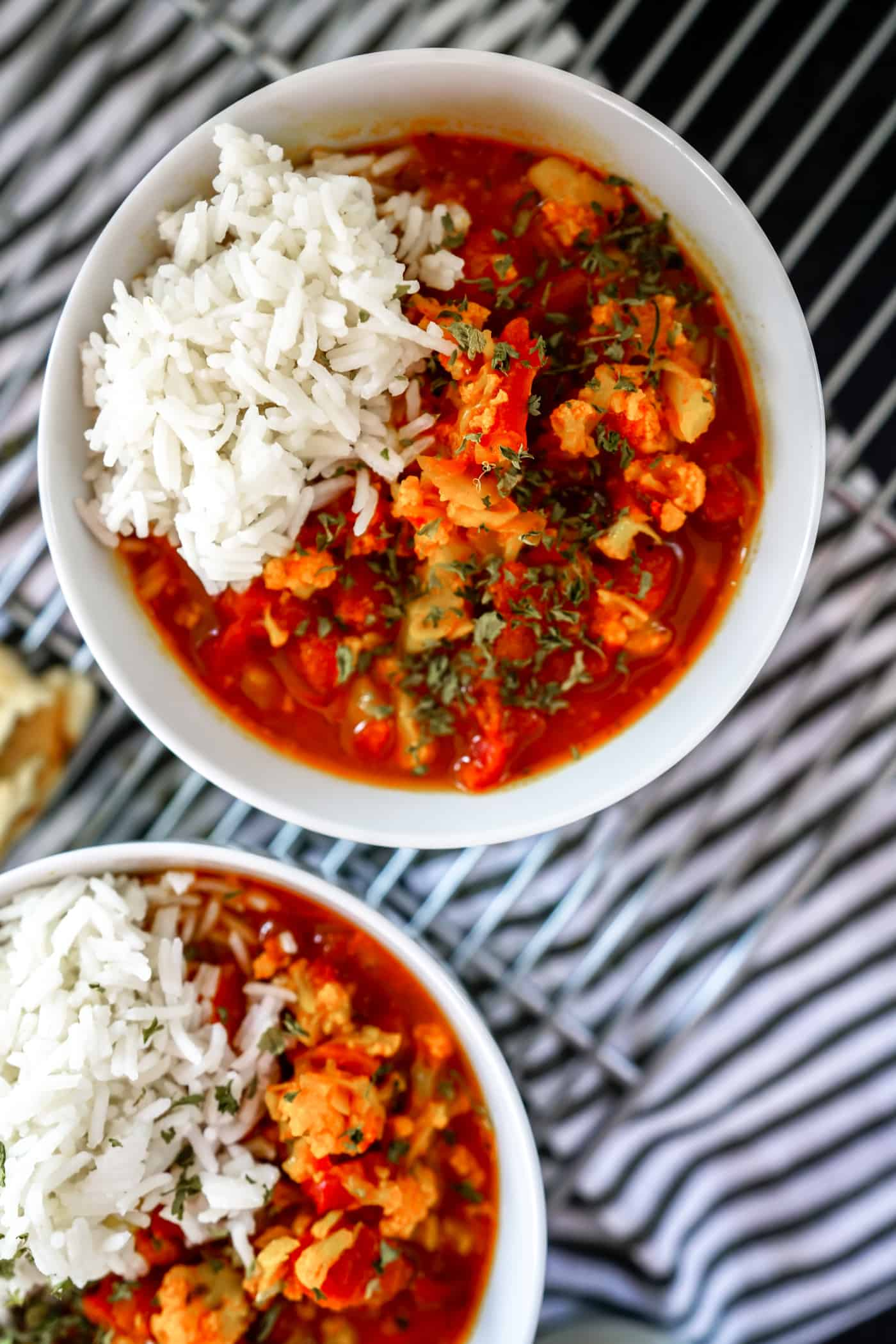 WOW! This Instant Pot Cauliflower Tikka Masala recipe is packed full of so much flavor! It's a must try! This recipe is so quick, easy, vegan friendly and will have your family running to the table! It's the best cauliflower tikka masala we have ever had!