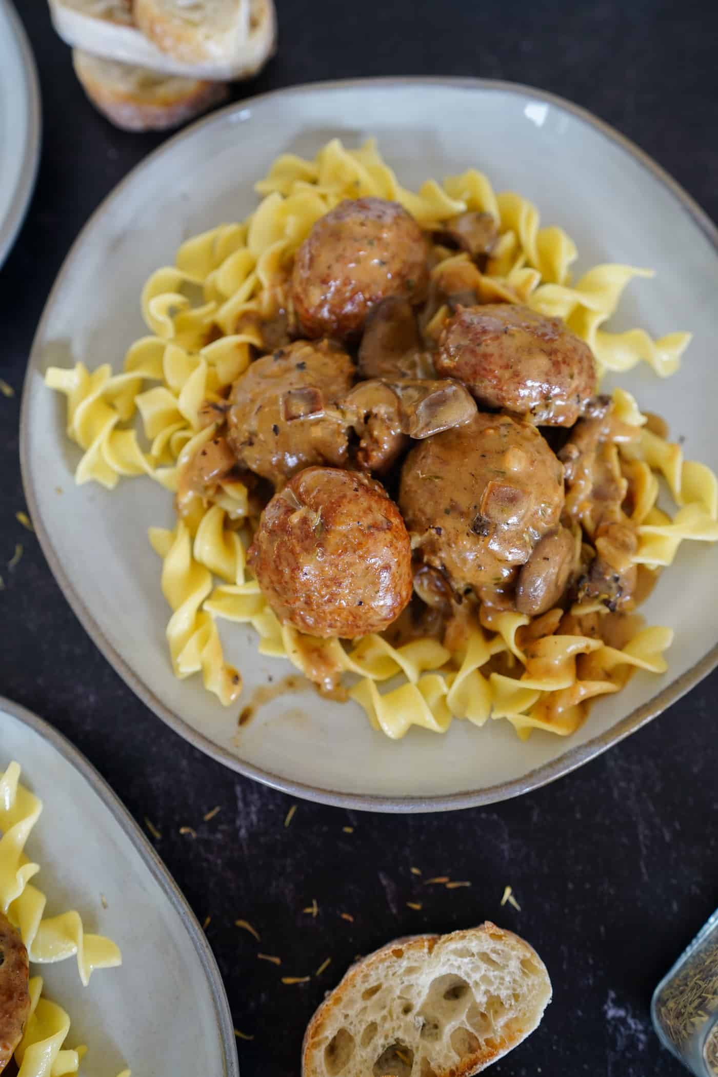 A large plate of meatball stroganoff with mushroom gravy served over egg noodles