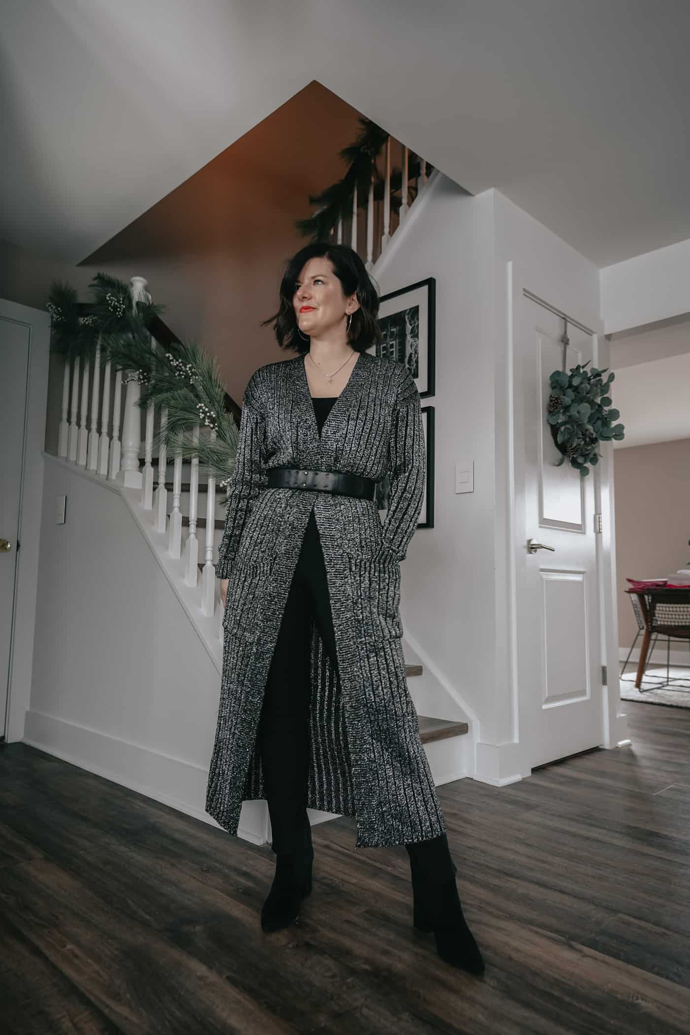 A Lily Love Affair showing you 5 ways to wear womens black pants. Wearing long grey cardigan, how to belt a cardigan, black ankle boots, work outfit, petite black pants, fall outfit ideas, what to wear to work, black pants to work, what to wear to work