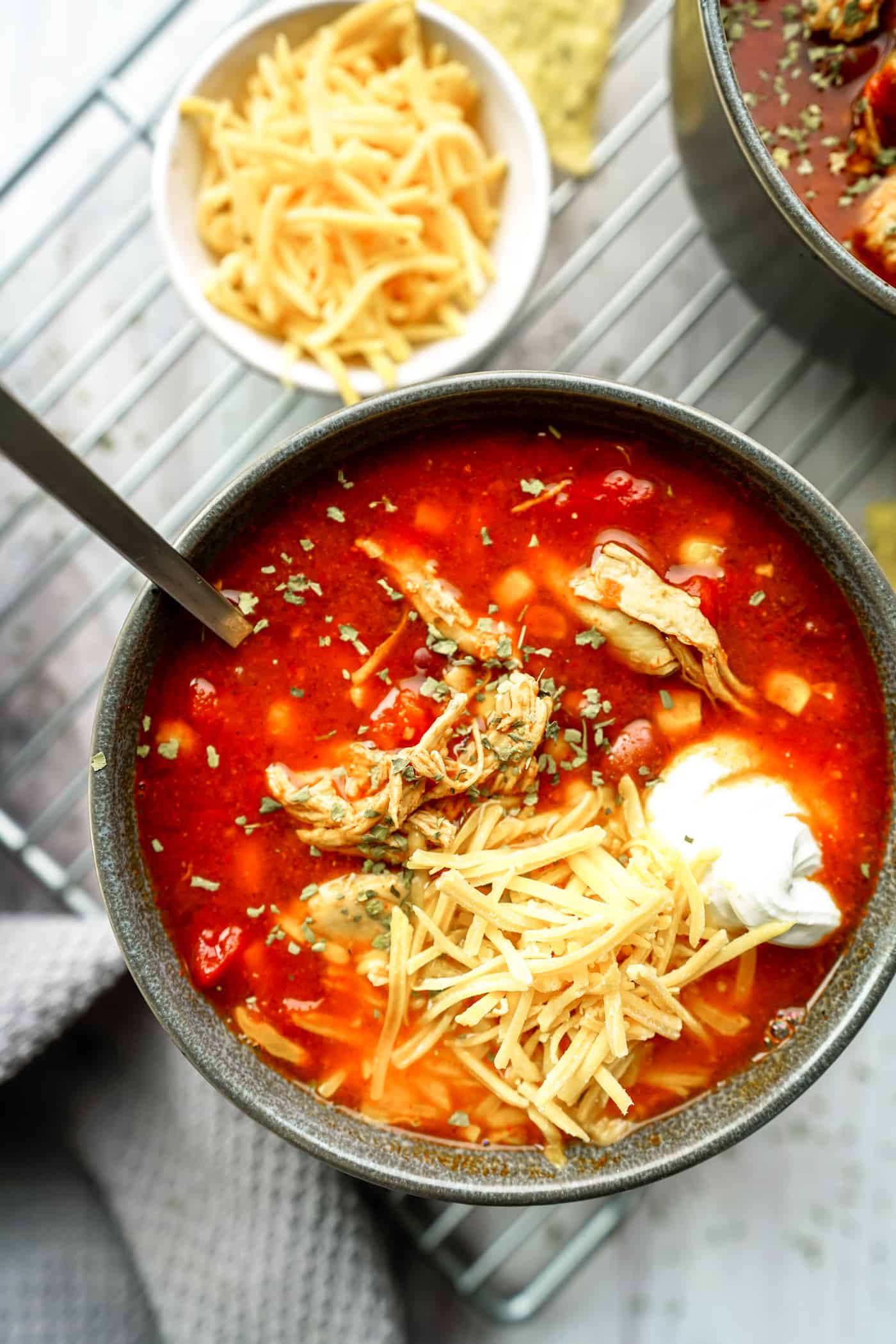 A Lily Love Affair shares Instant Pot Chicken Enchilada soup recipe with cheese and tortilla chips