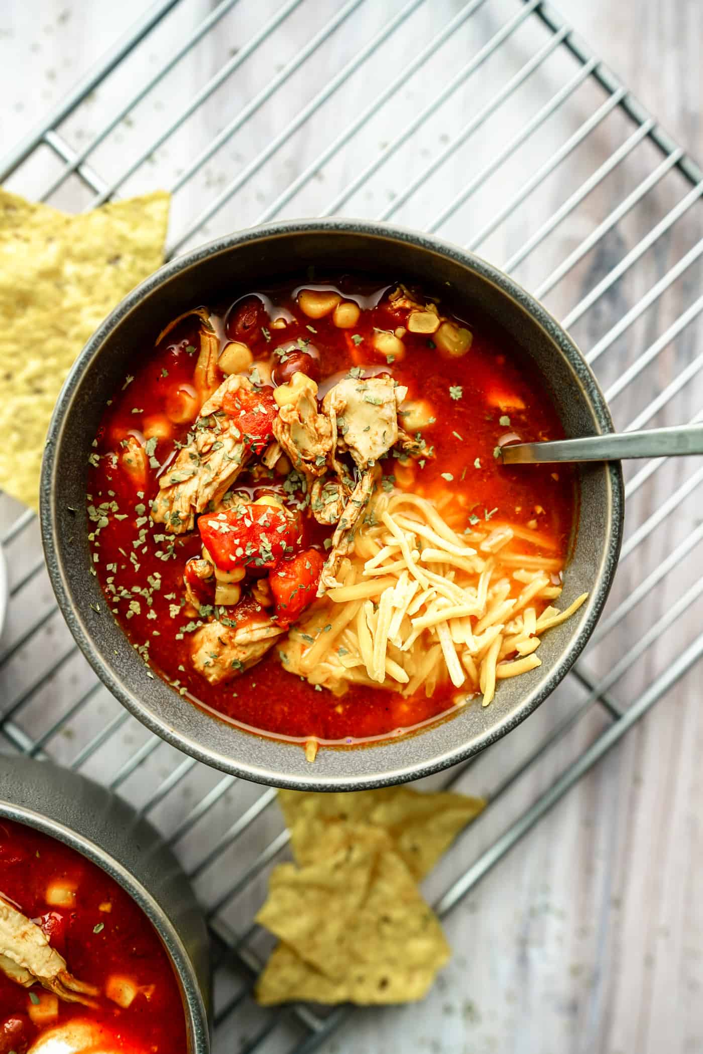 Need a quick and easy dinner for this week? This Instant Pot Chicken Enchilada Soup is one of the quickest, easiest and most flavorful recipes you'll make in your Instant Pot! Simply dump the ingredients into your Instant Pot, cook for 10 minutes and serve!