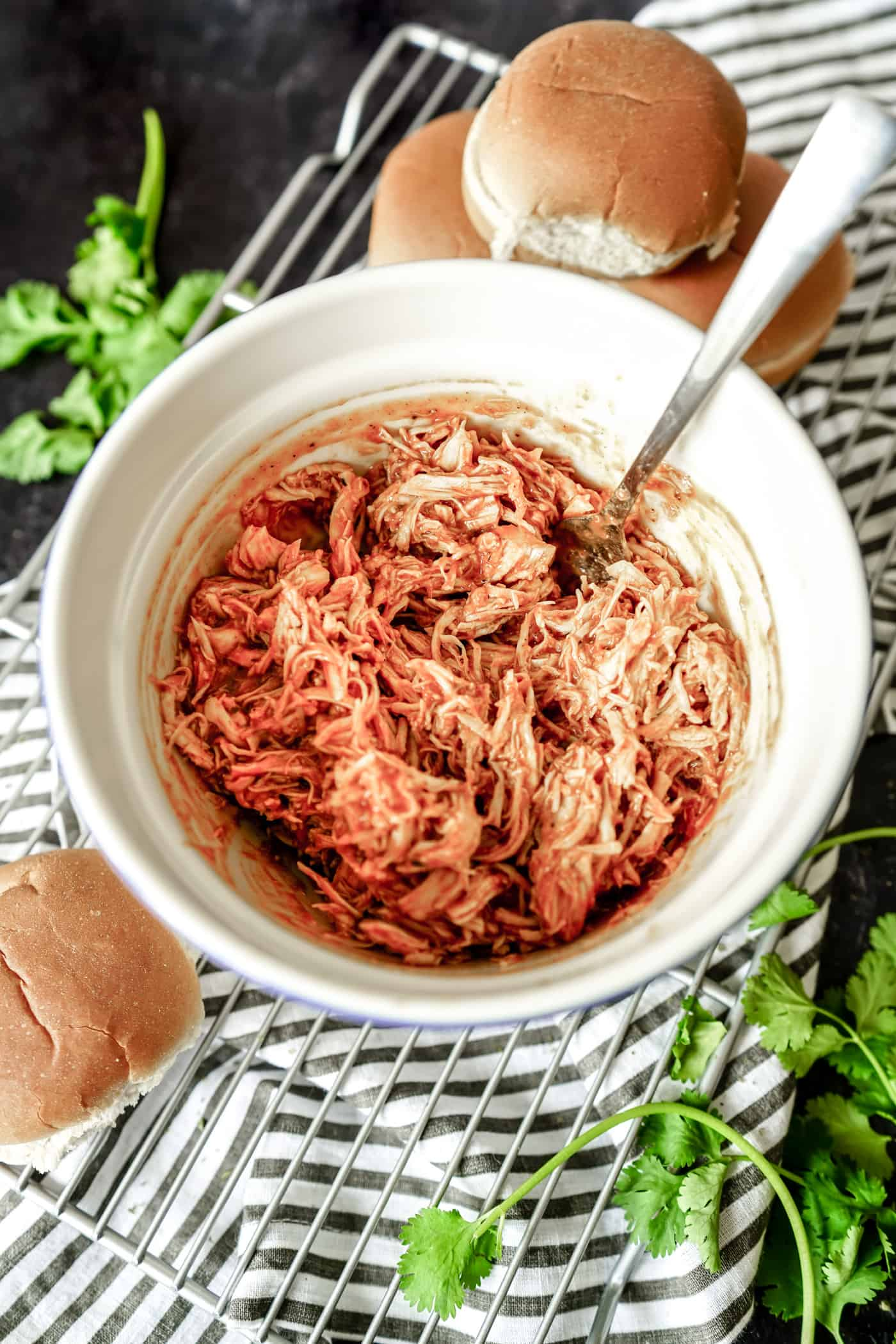 A large bowl of shredded barbeque chicken