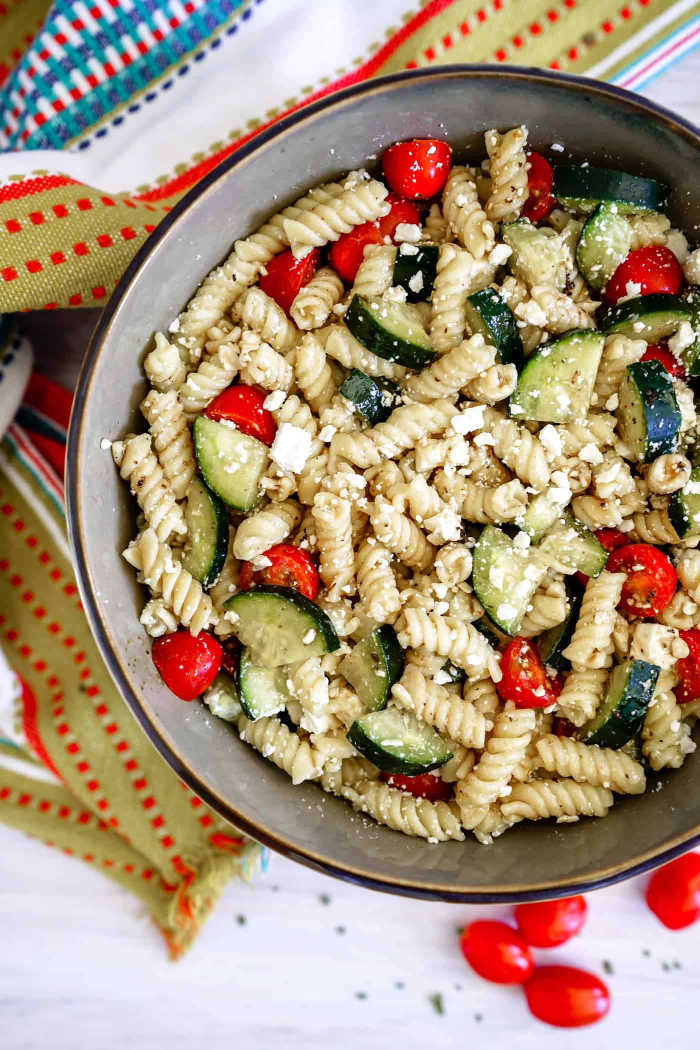 Large bowl filled with Instant Pot Pasta Salad with tomatoes and cucumbers