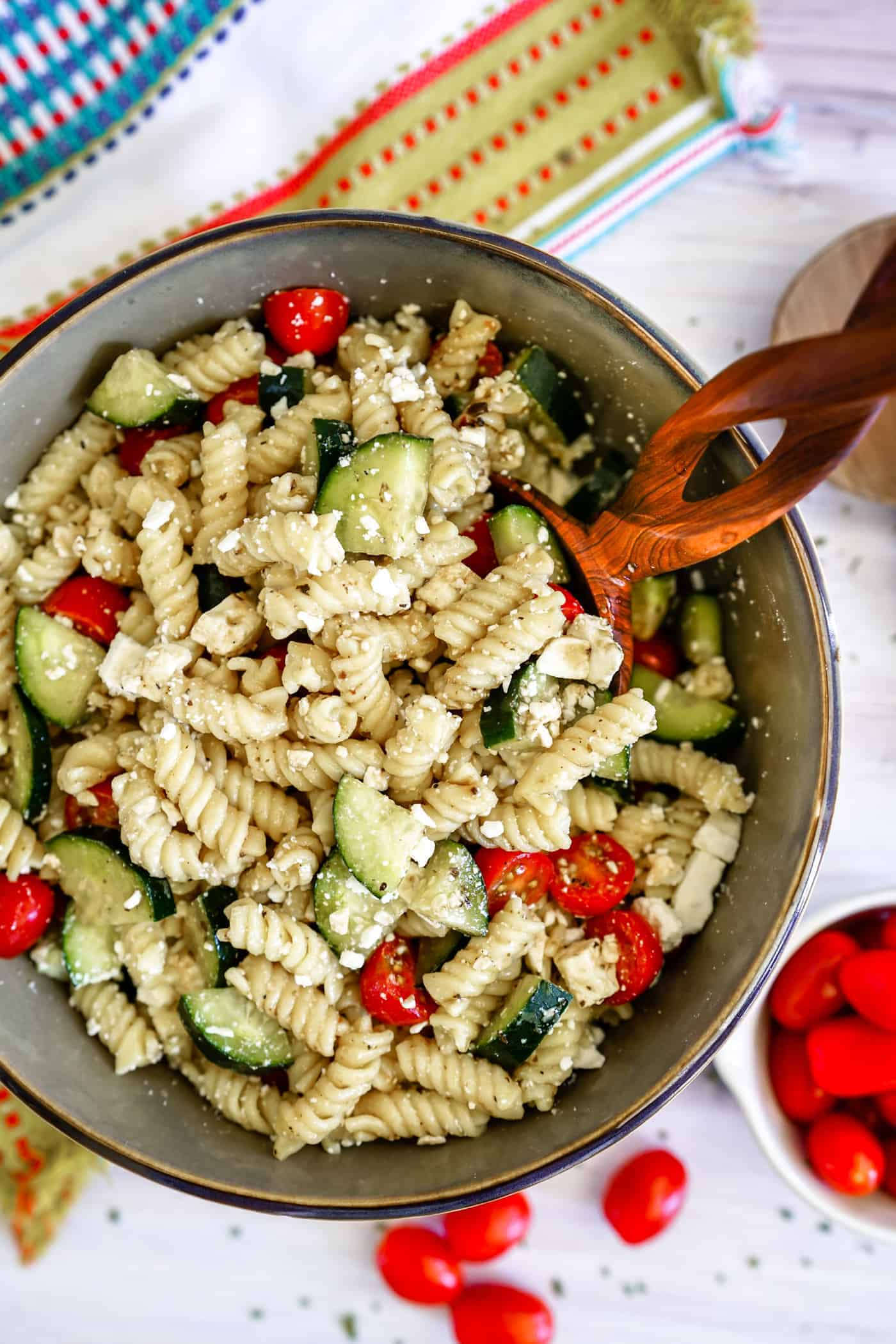 Large bowl filled with easy Instant Pot Pasta Salad with tomatoes and cucumbers