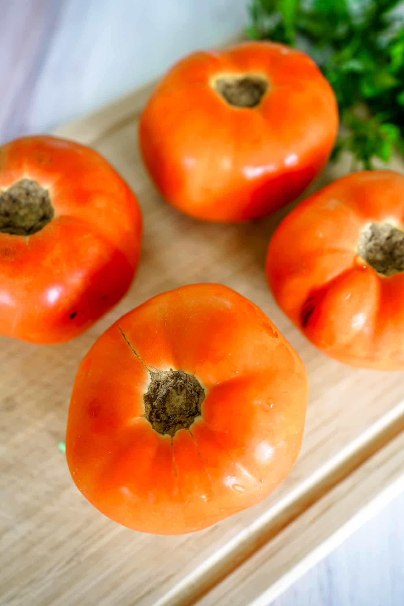 A Lily Love Affair shares stuffed tomato recipe with sweet corn, spicy Italian sausage. Keto friendly recipe, vegan recipe, easy dinner idea