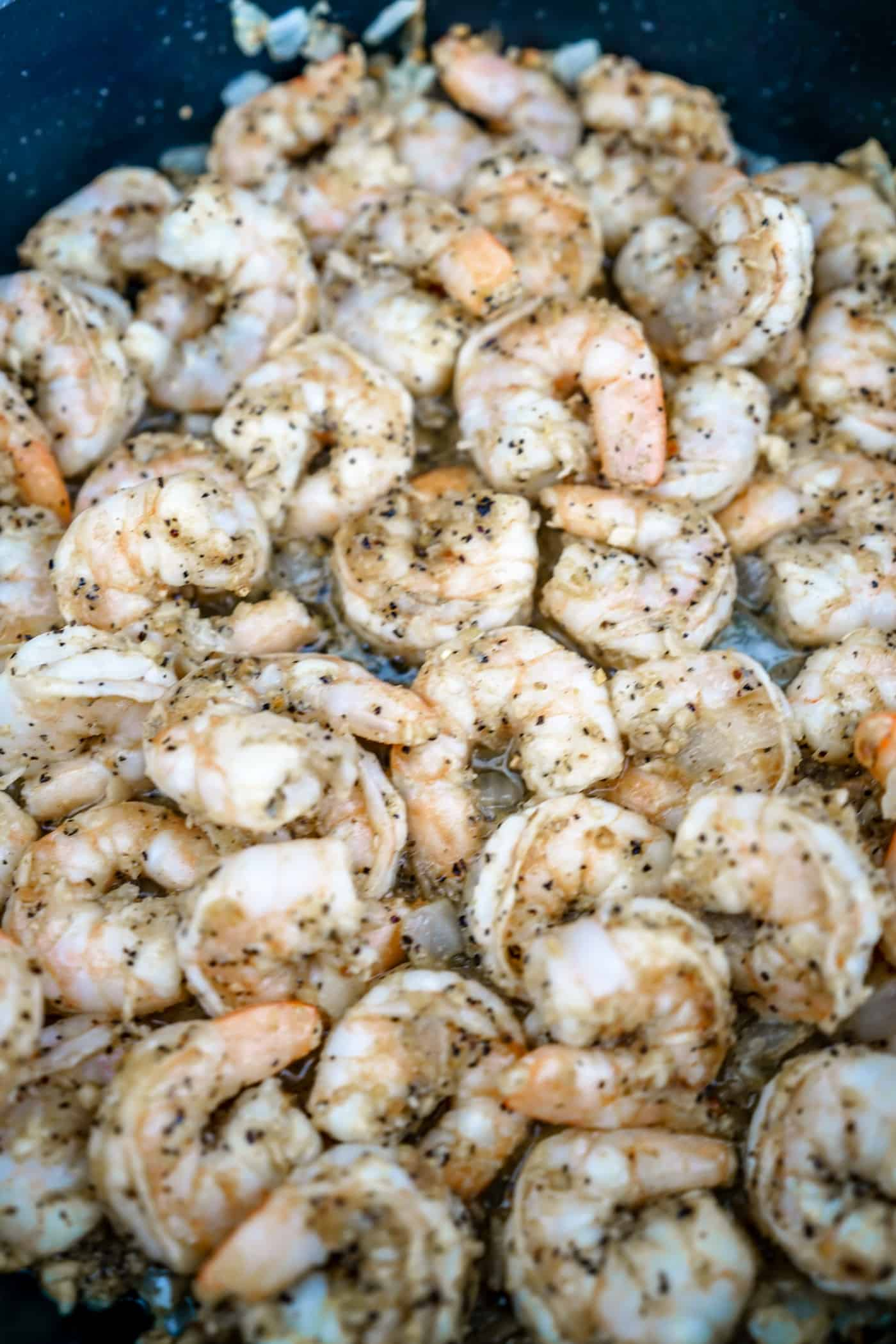 Lemon Pepper shrimp cooling in a large skillet