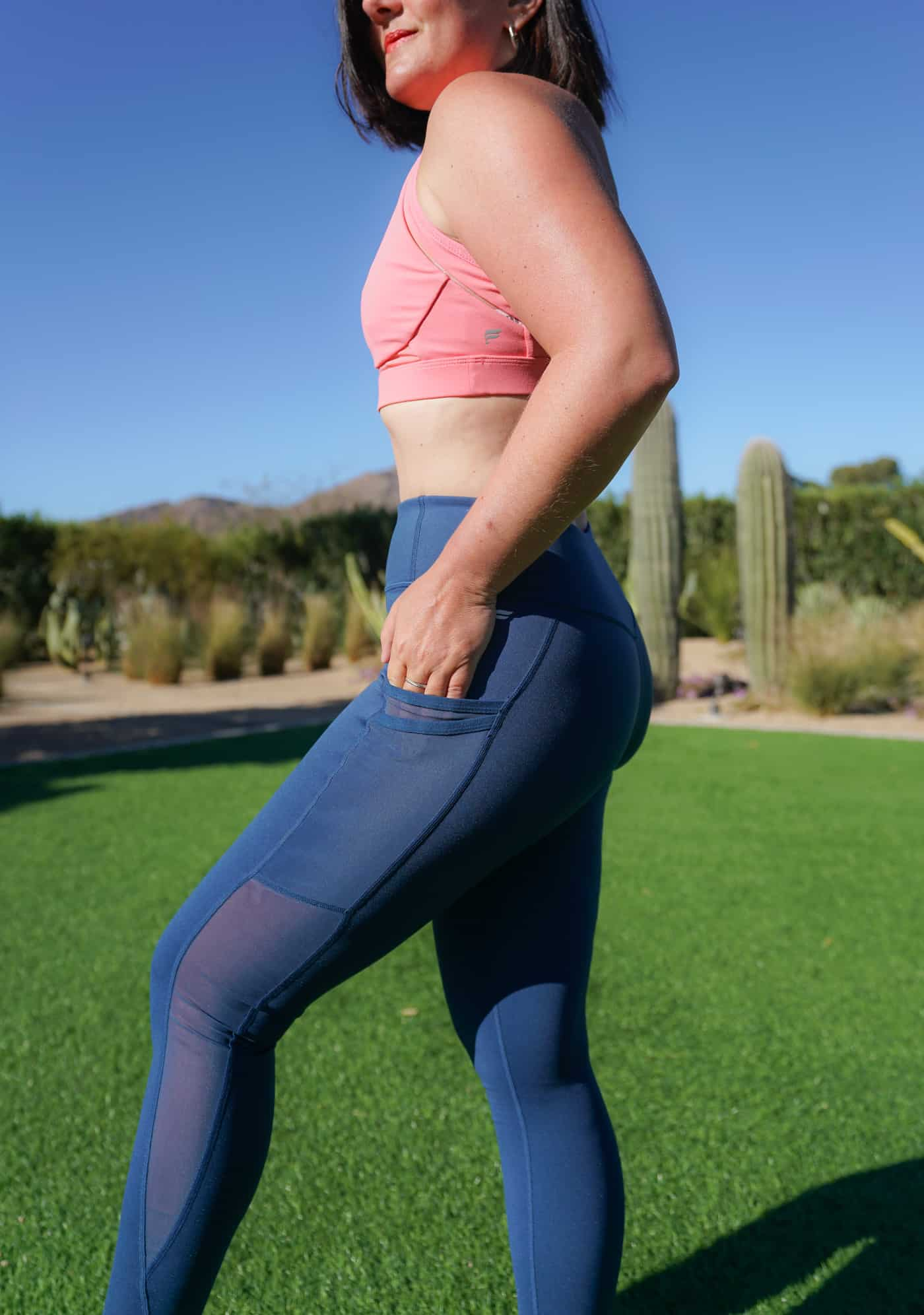 A women wearing Fabletics leggings and sports bra sharing a detailed Fabletics review