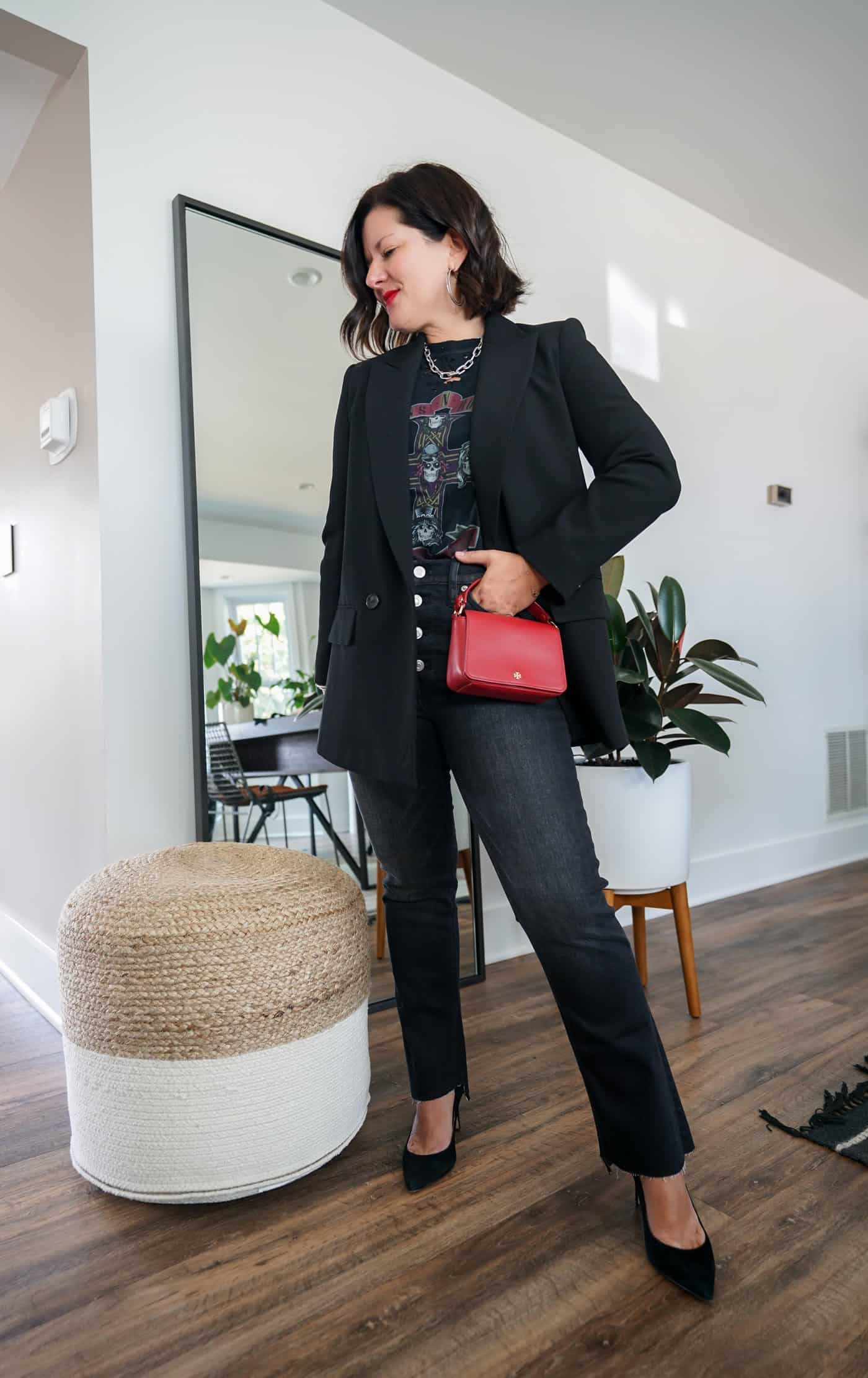 A womens black blazer with jeans and black heels