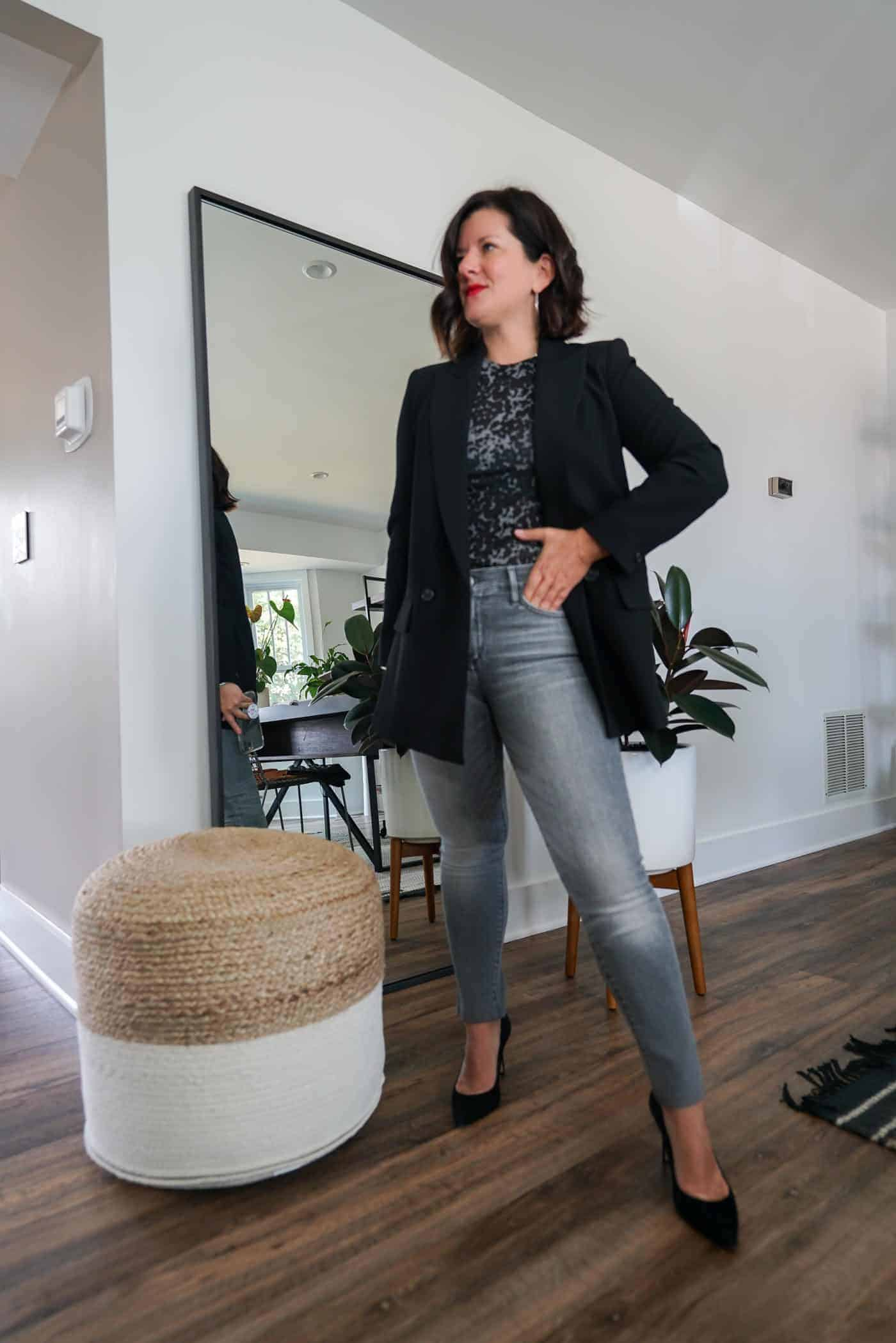 Womens black blazer and grey denim jeans