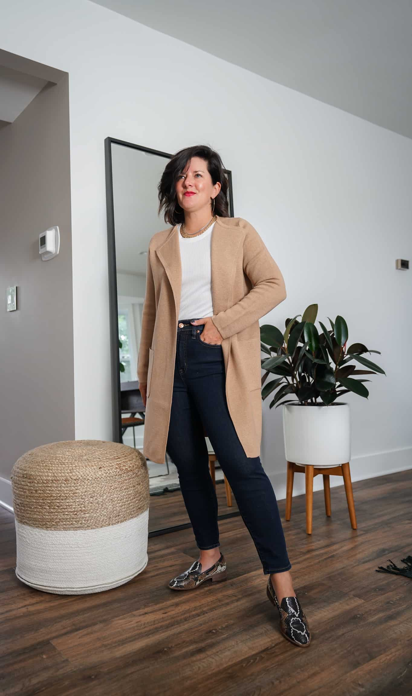 A Lily Love Affair shares how to wear a long tan cardigan with a white top and snakeskin flats