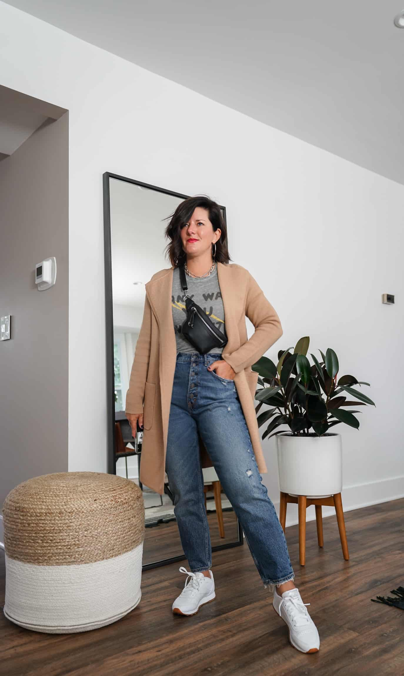A Lily Love Affair shares how to wear a long cardigan with straight leg jeans, a graphic tee and white sneakers