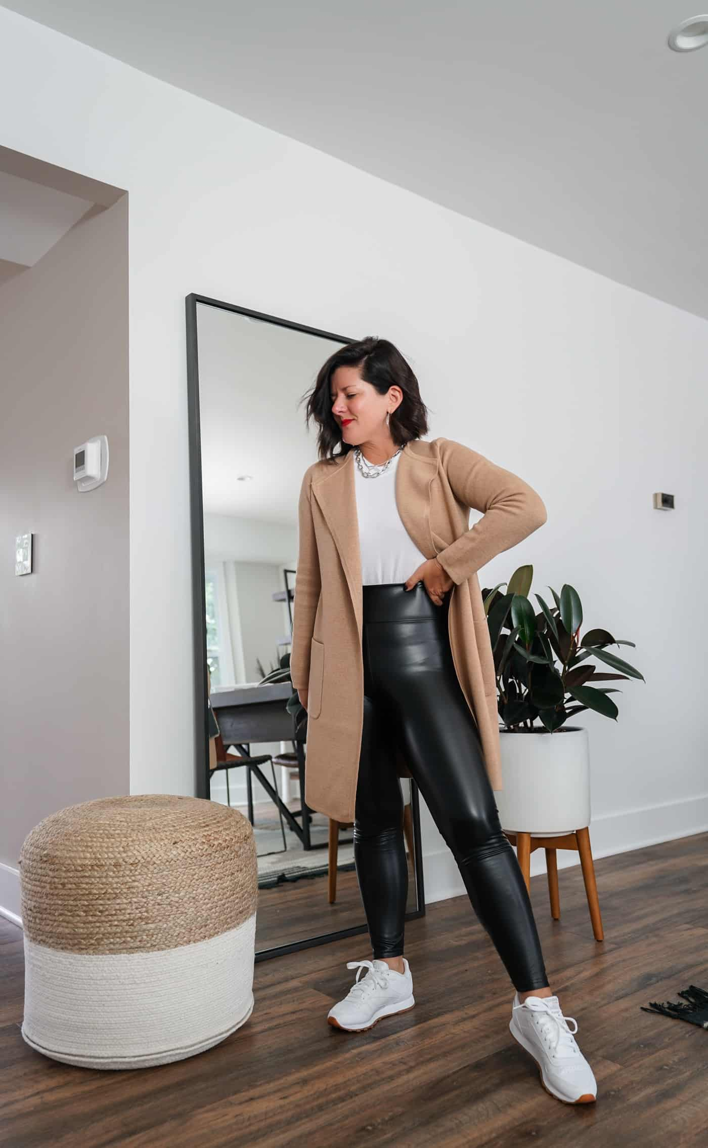 A Lily Love Affair shares how to wear a long cardigan with faux leather leggings and reebok classic sneakers