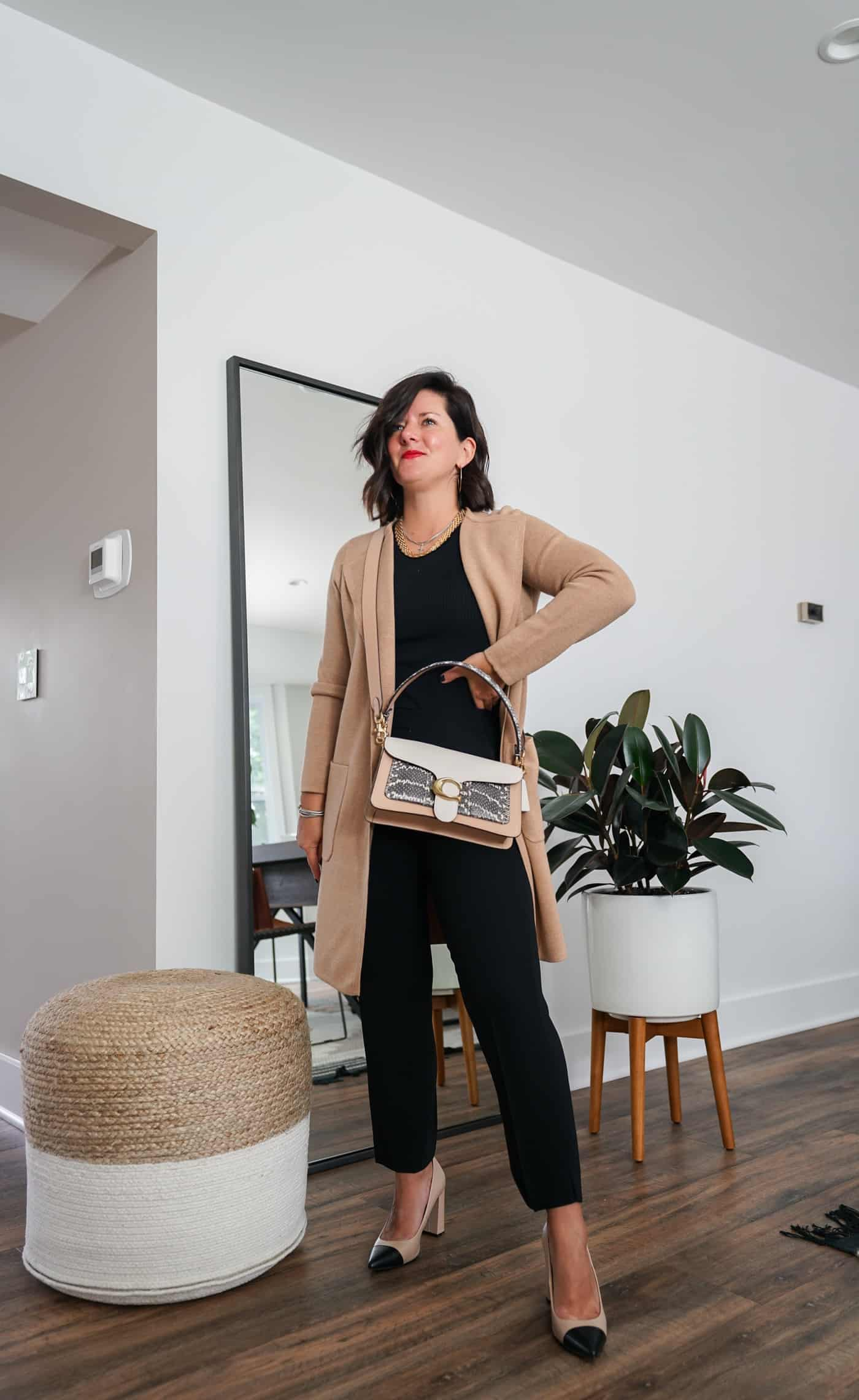 A Lily Love Affair shares how to wear a long cardigan with black dress pants and heels