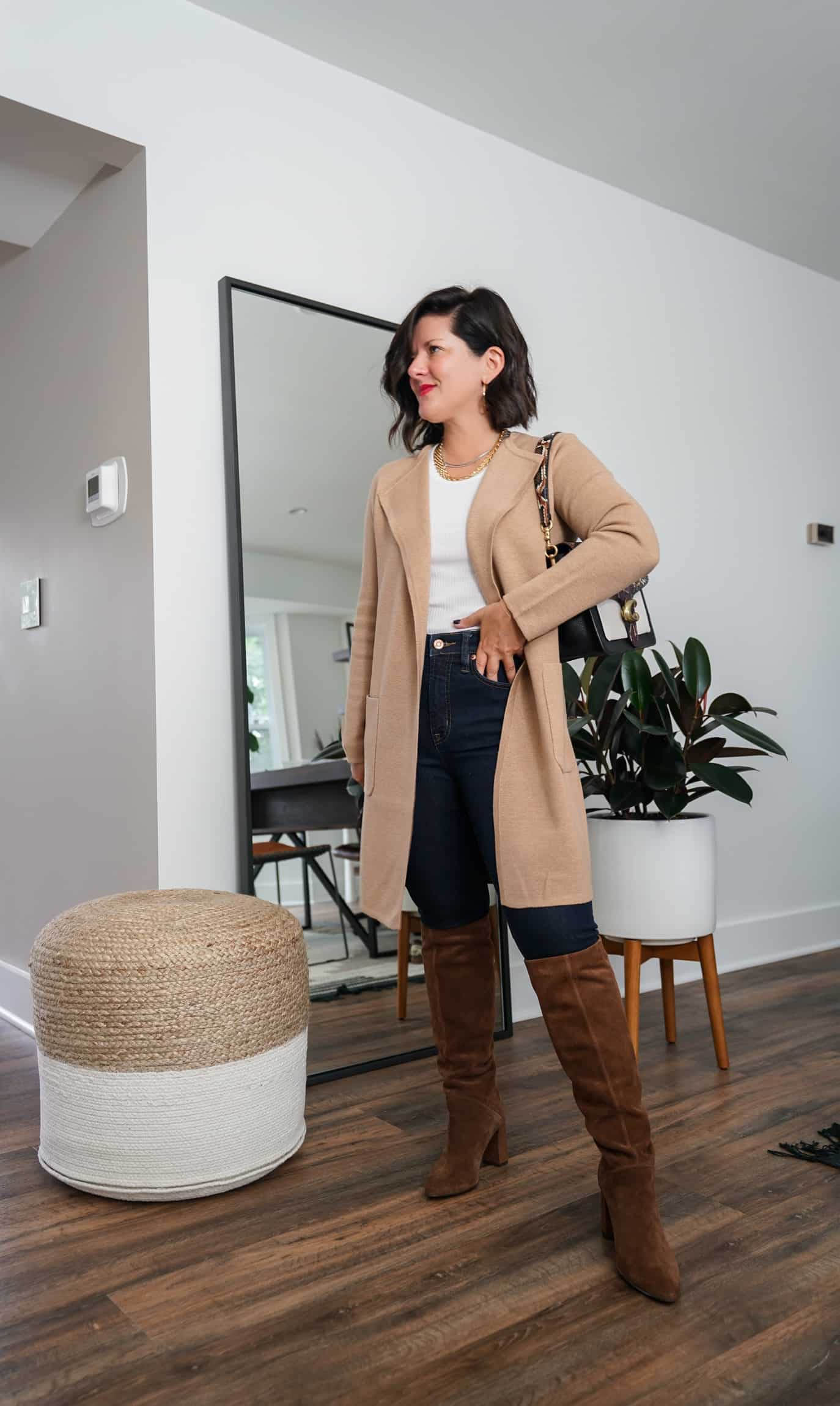 A Lily Love Affair shares how to wear a long cardigan with brown knee high boots, skinny jeans and a white tank top