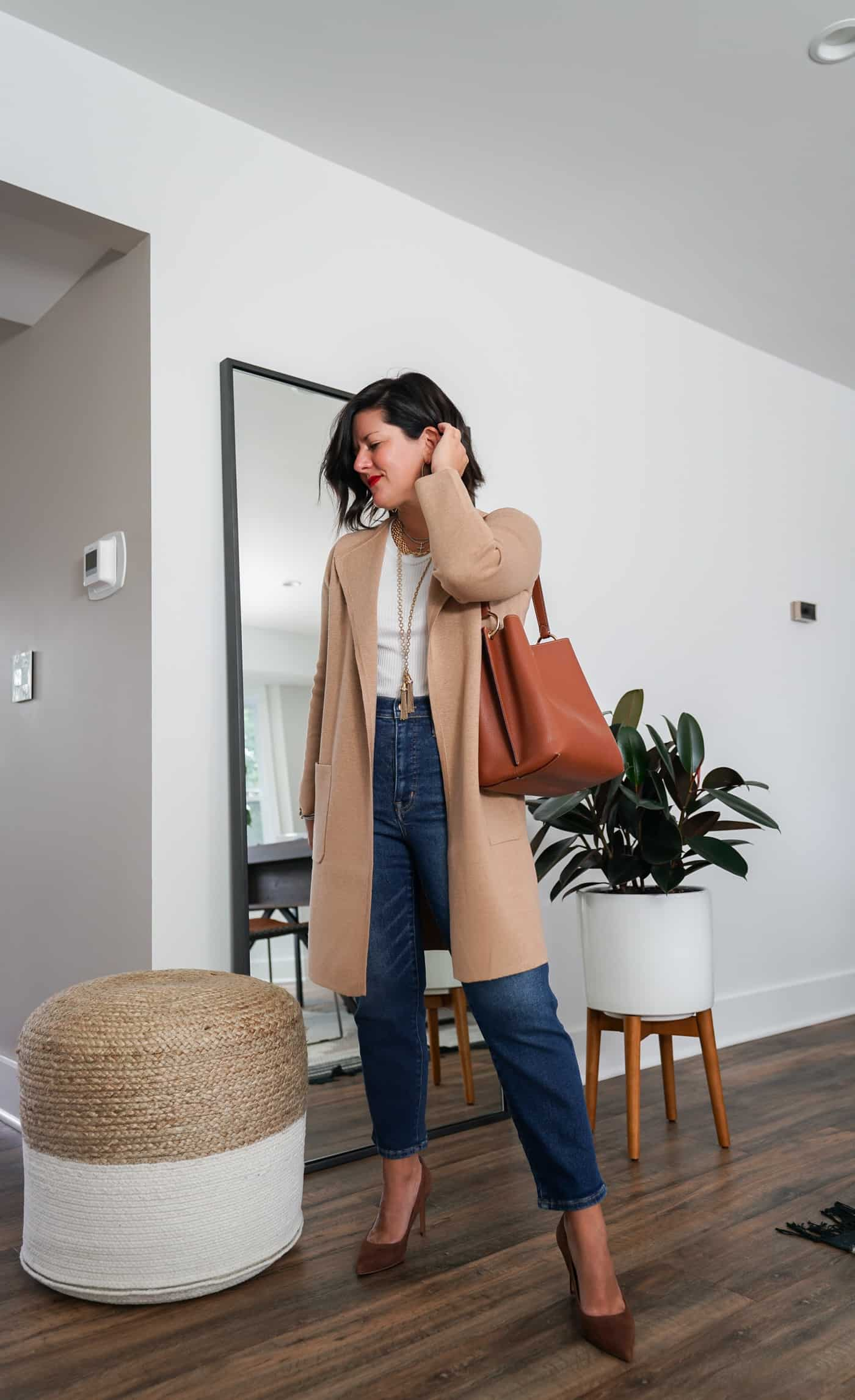 A Lily Love Affair shares how to wear a long cardigan with straight leg denim and brown heels