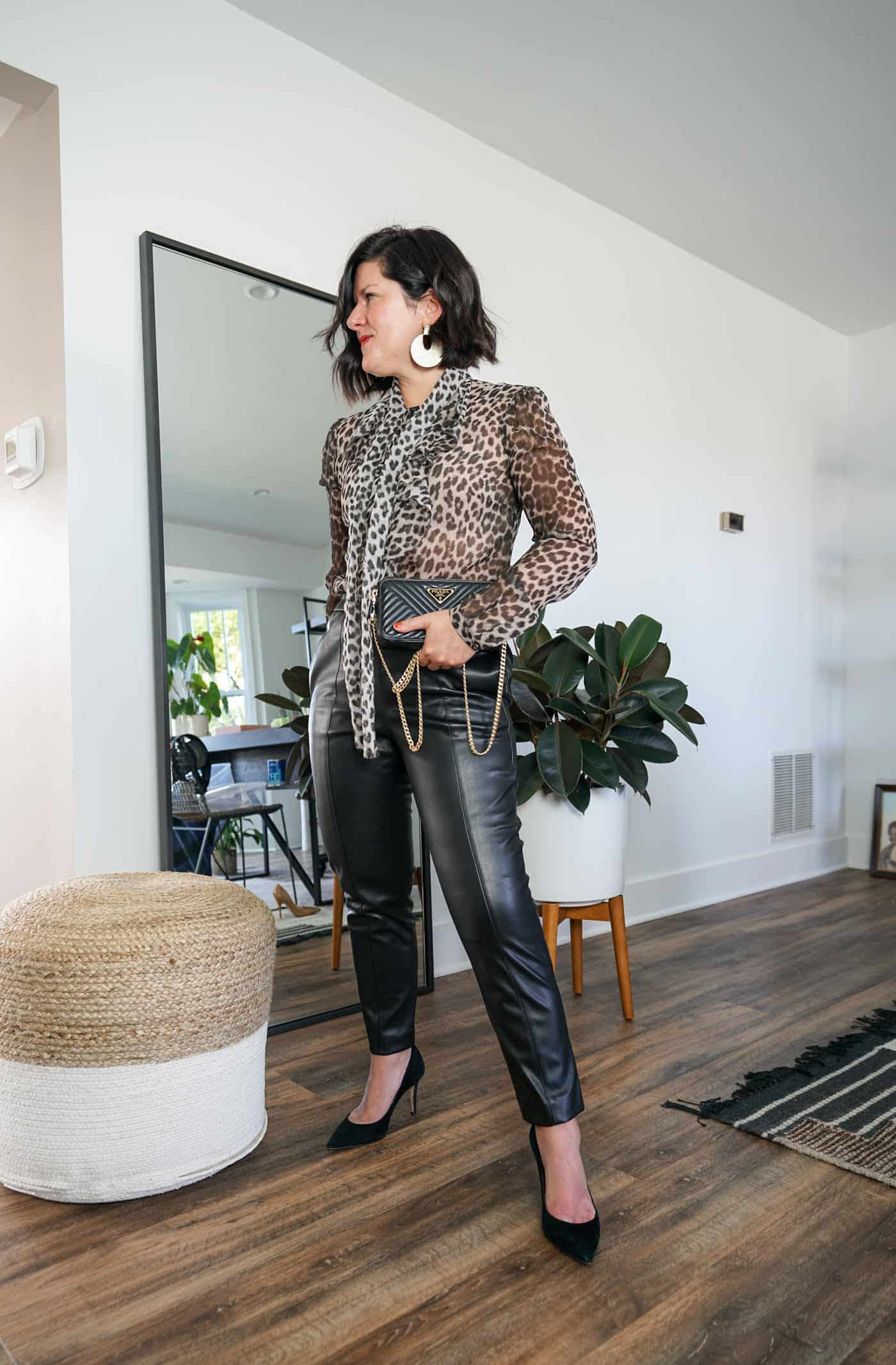 A Lily Love Affair wearing womes faux leather pants with a leopard blouse and black high heels