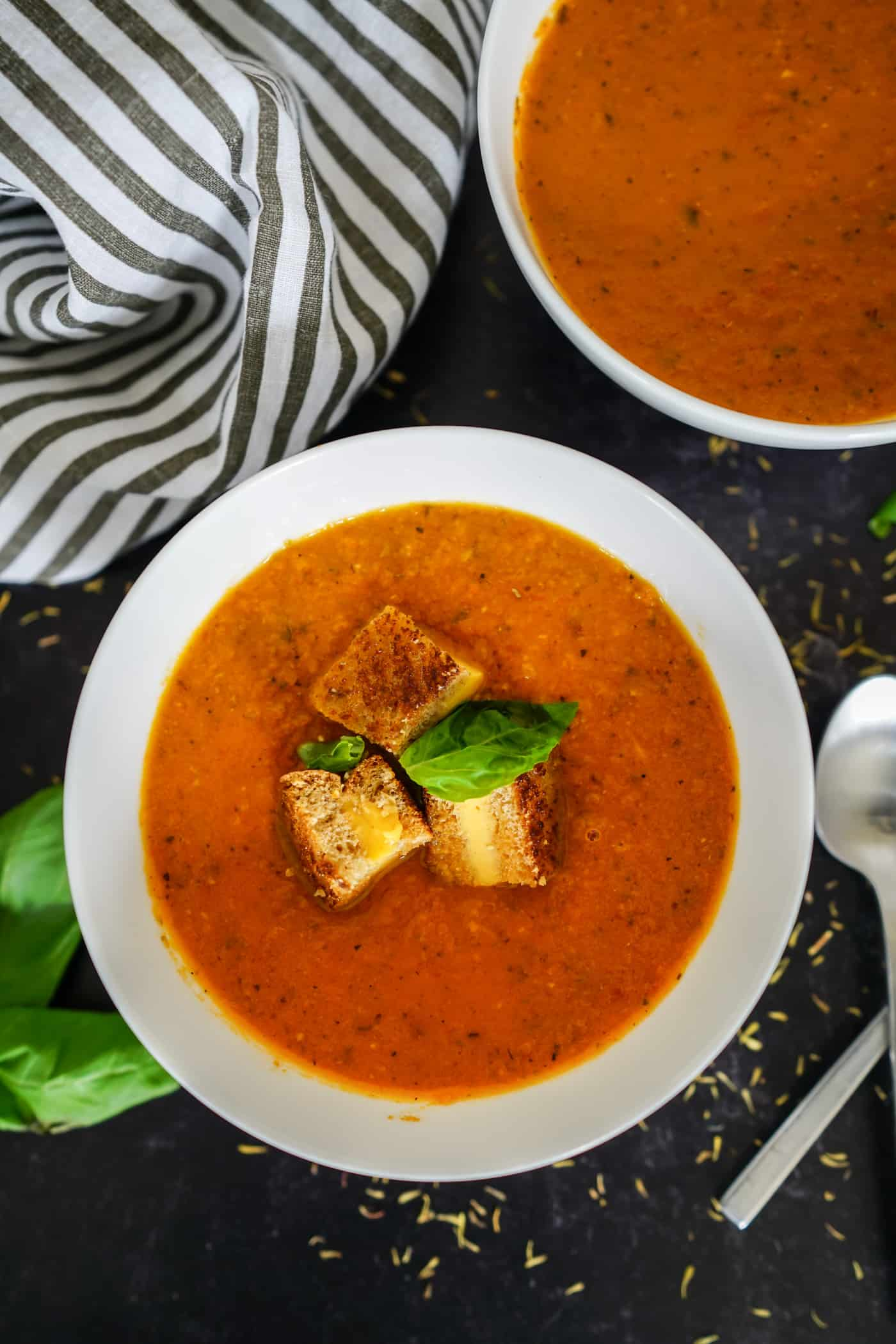 A Lily Love Affair shares a recipe for Instant Pot Tomato Basil Soup topped with grilled cheese crutons