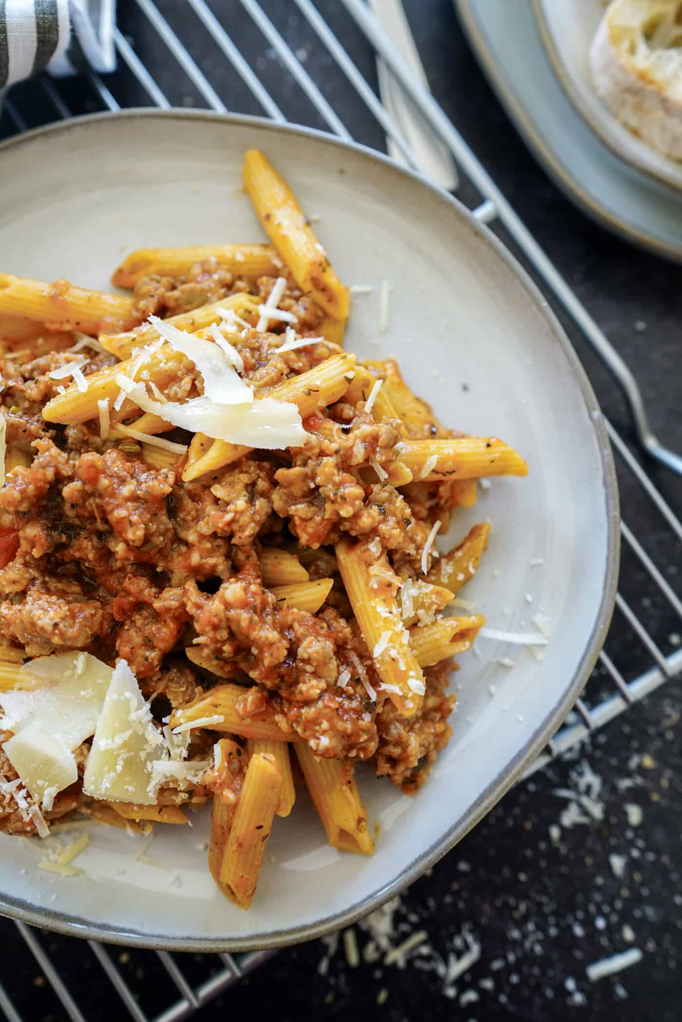 A plate of Instant Pot Penne Pasta made with suasage and parmesan cheese