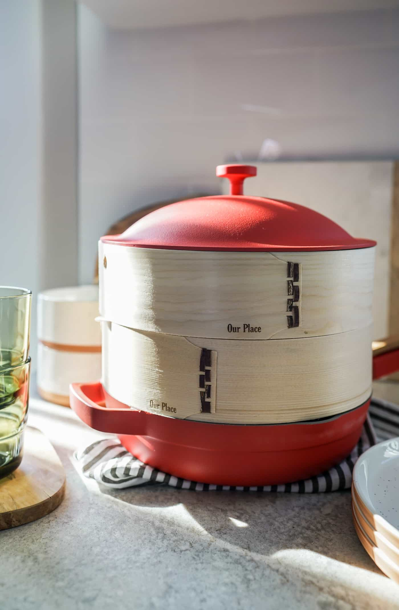 The Our Place Always Pan in color Heat with bamboo steamer inserts