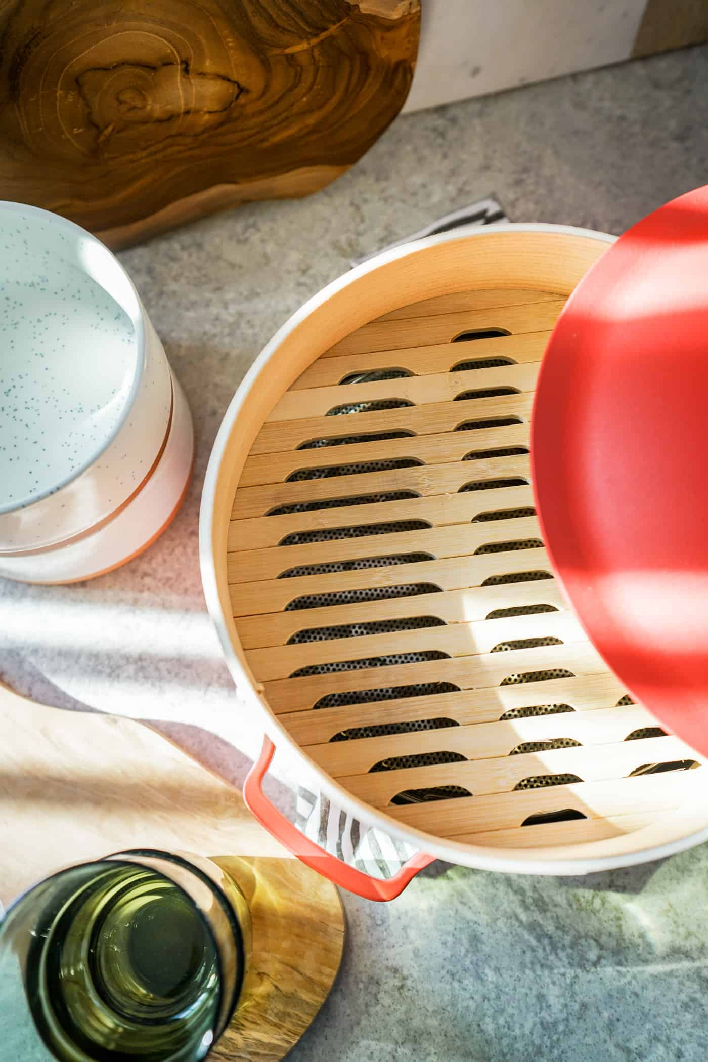 The Our Place Always Pan in color Heat with bamboo steamer insert.