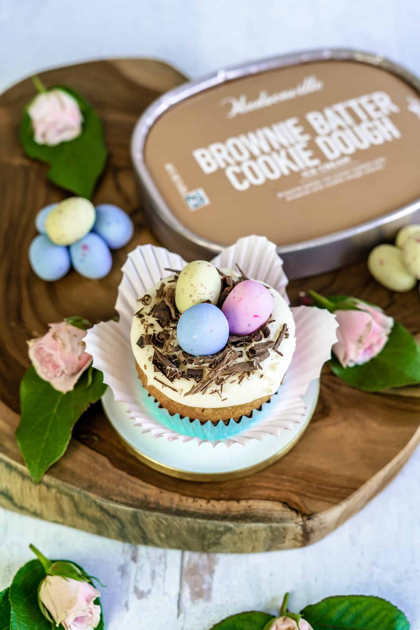 One Easter Egg Cupcakes topped with chocolate and easter eggs