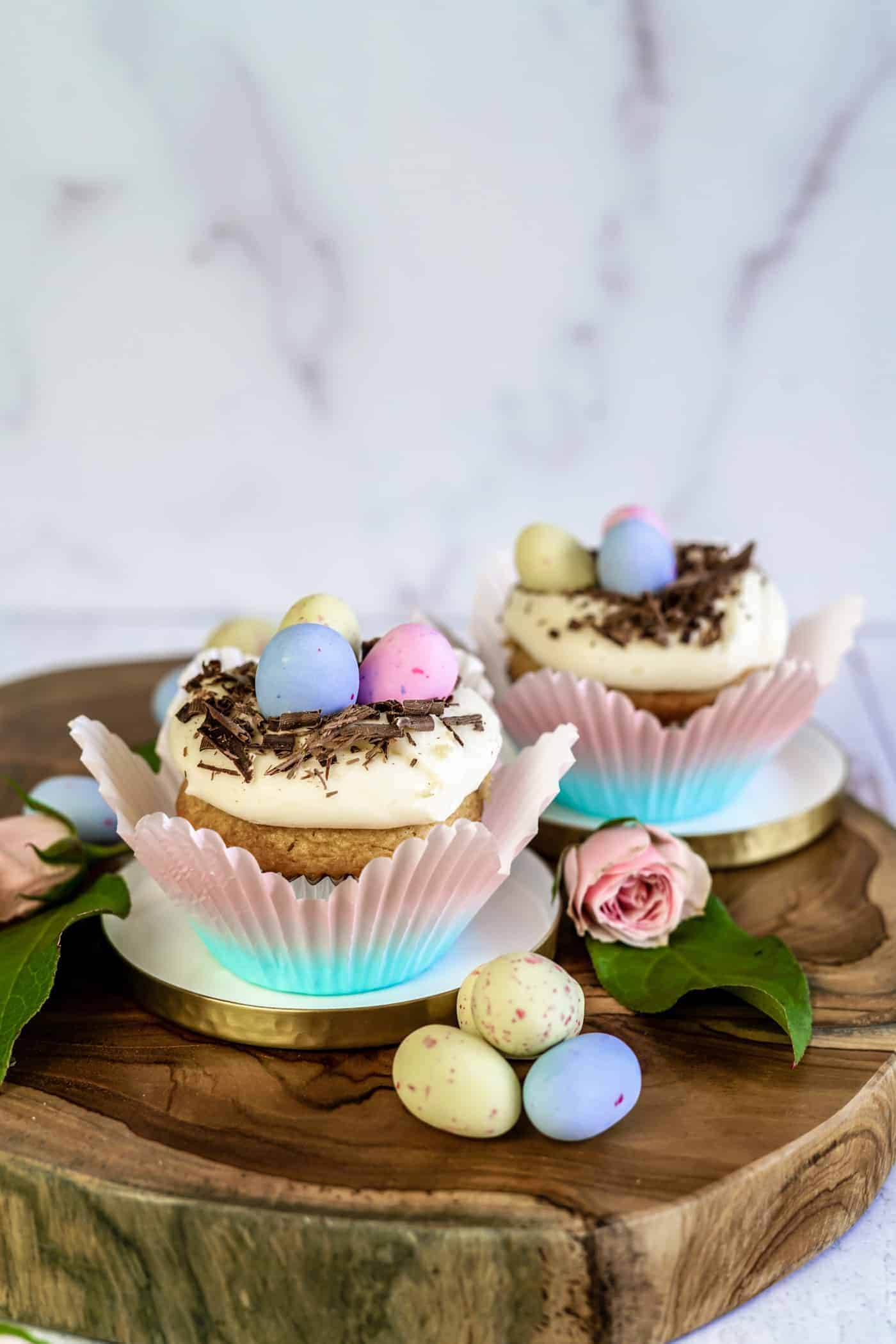 Two Easter Egg Cupcakes topped with chocolate and easter eggs