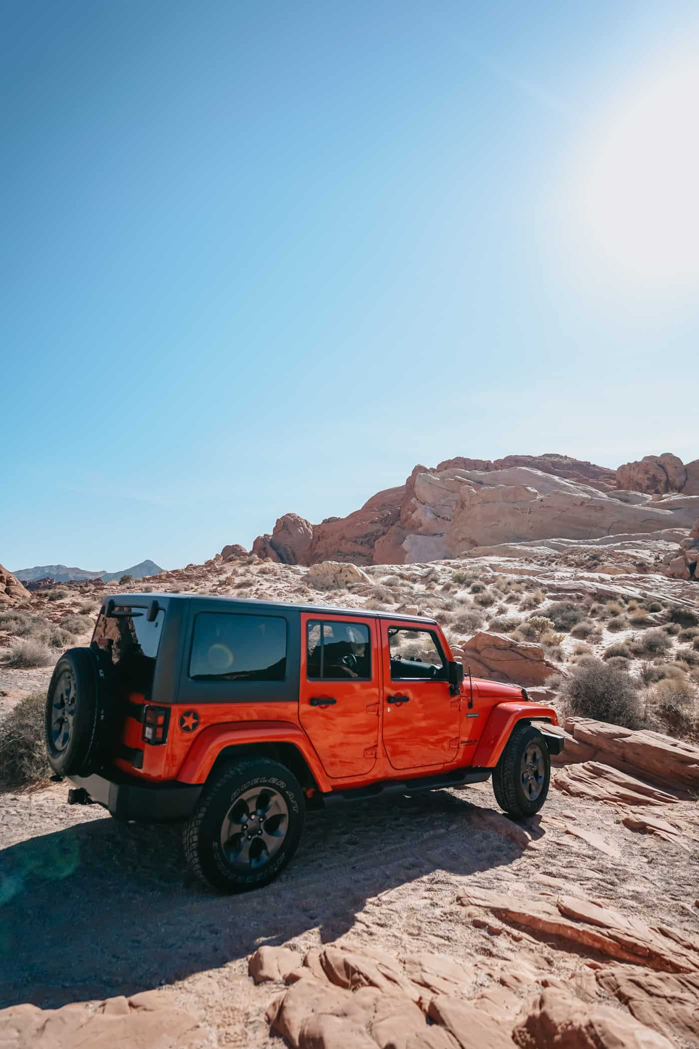 A red Jeep Wrangler at Arches National Park.
