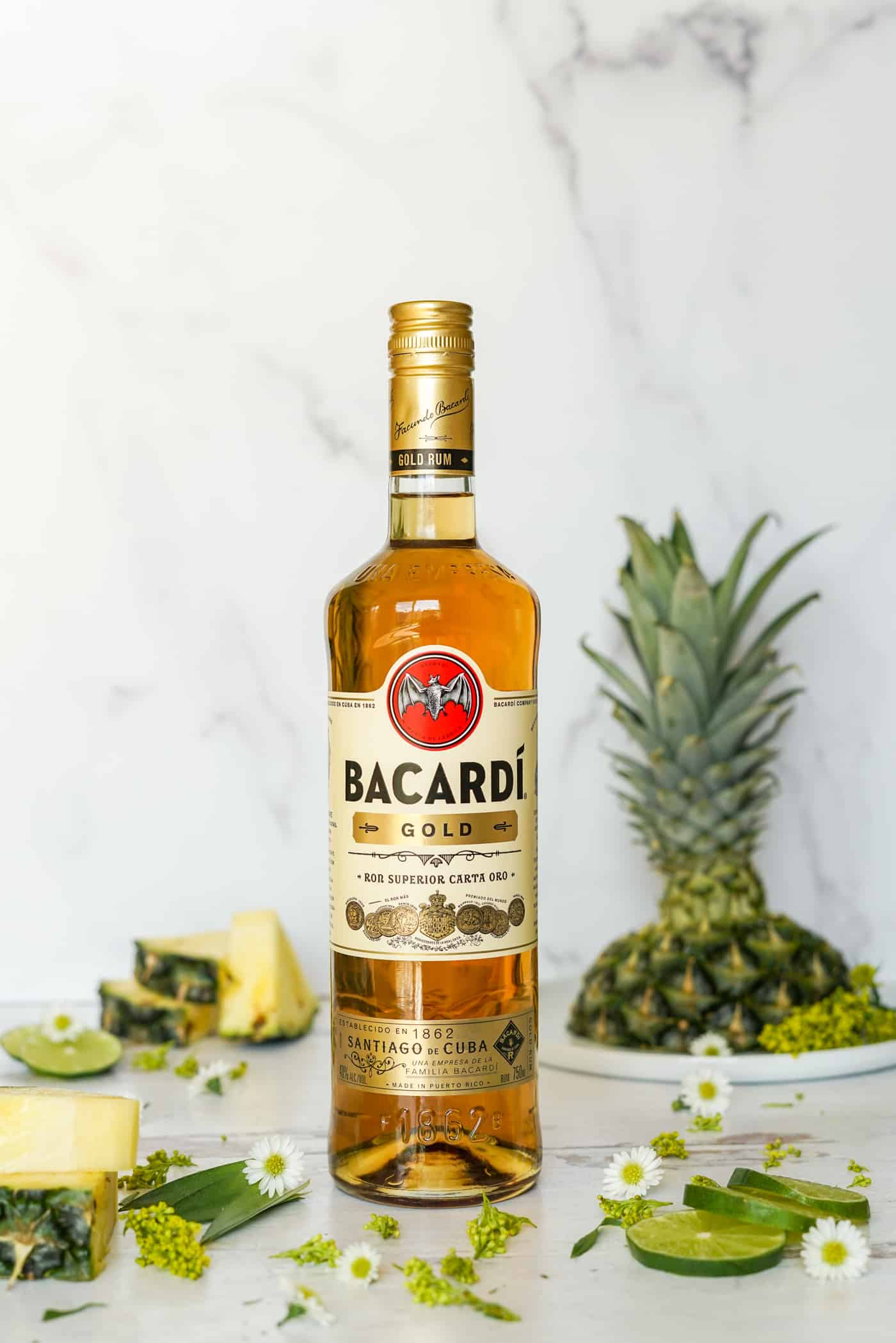 a tall bottle of Bacardi Superior Gold Rum