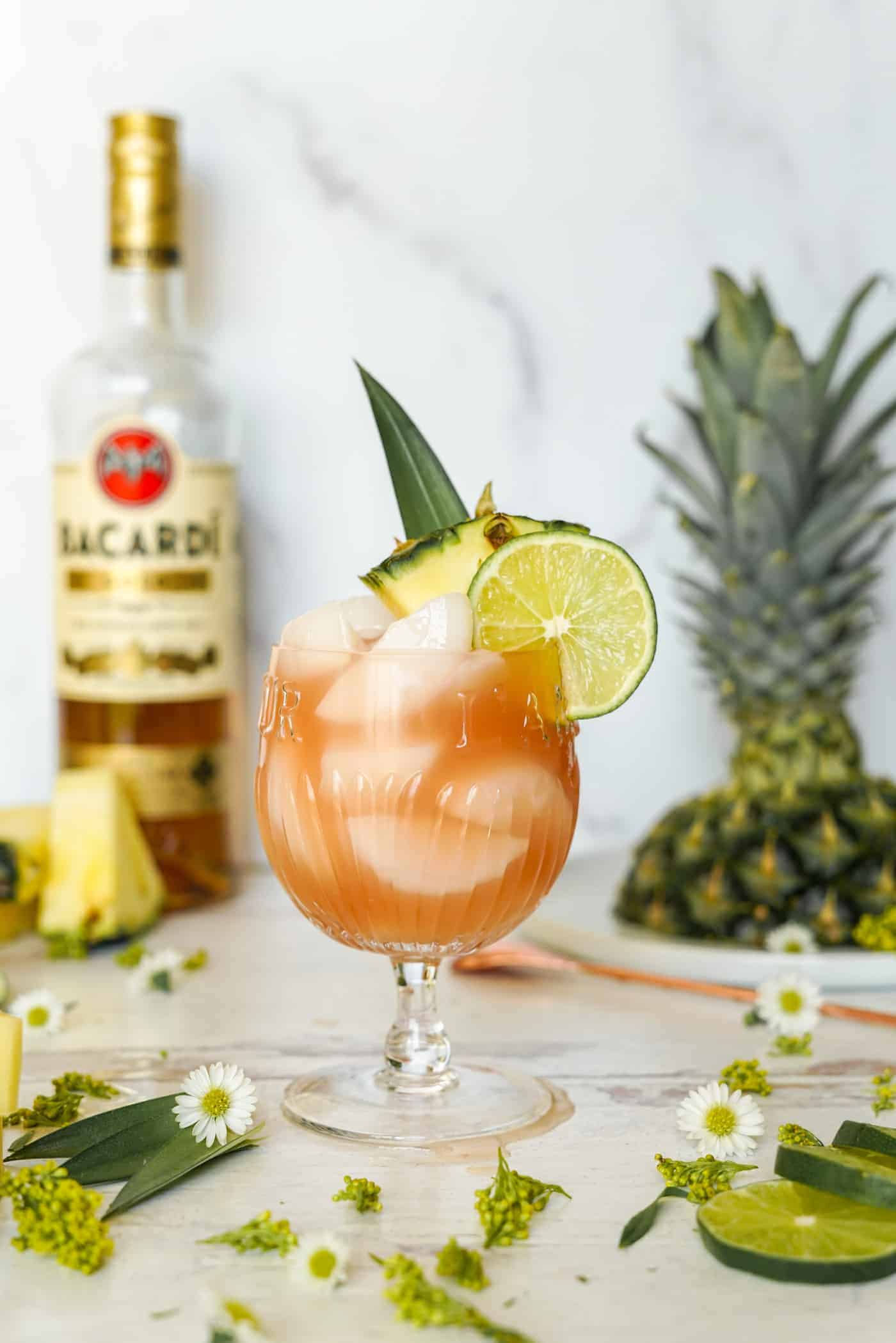A glass filled with Bacardi rum punch topped with a lime wedge