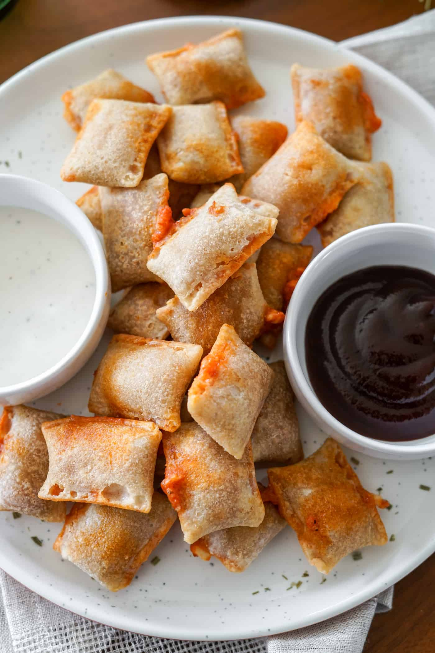 A plate of air fryer pizza rolls with ranch dipping sauce
