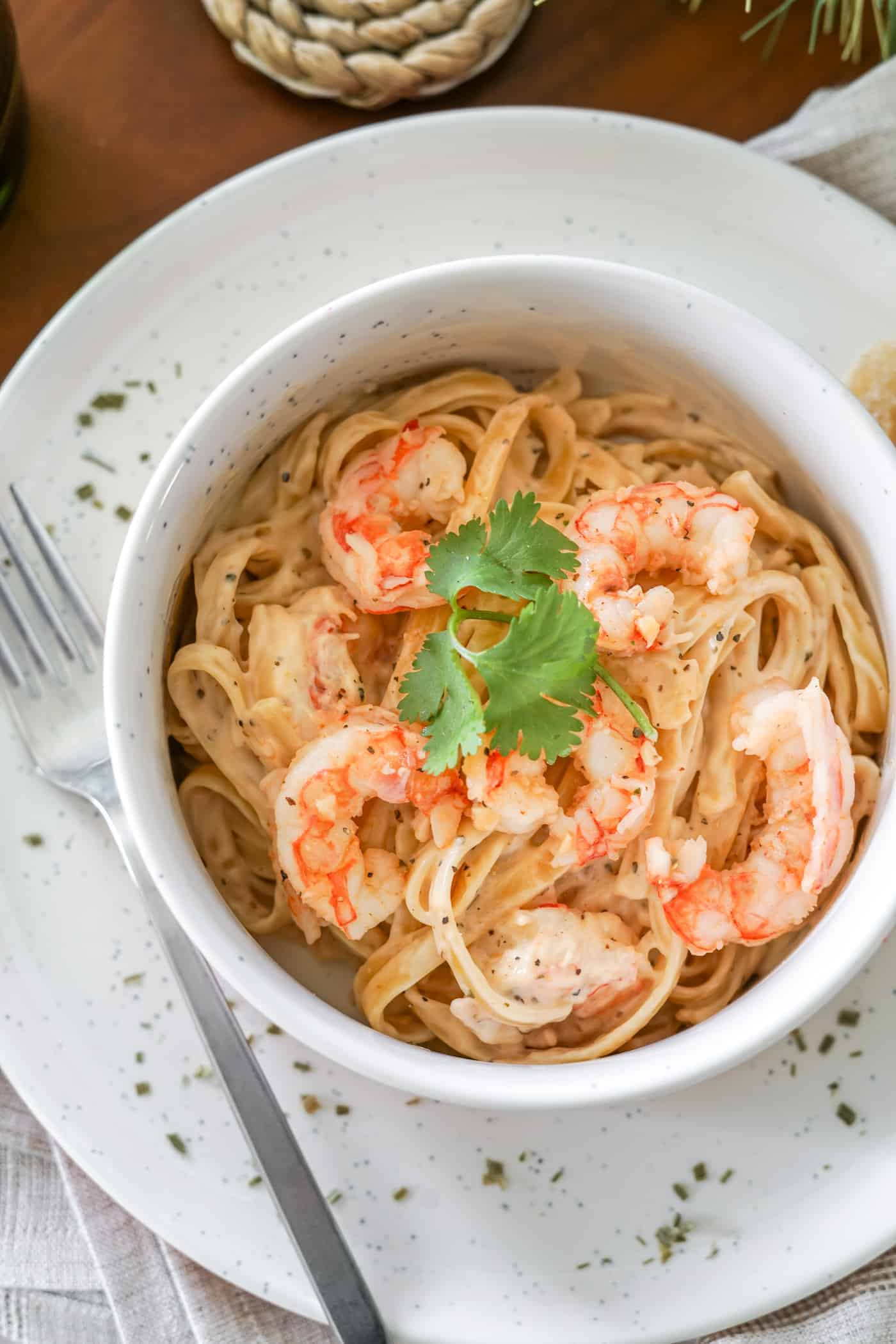 A bowl filled with Instant Pot shrimp alfredo with jar sauce