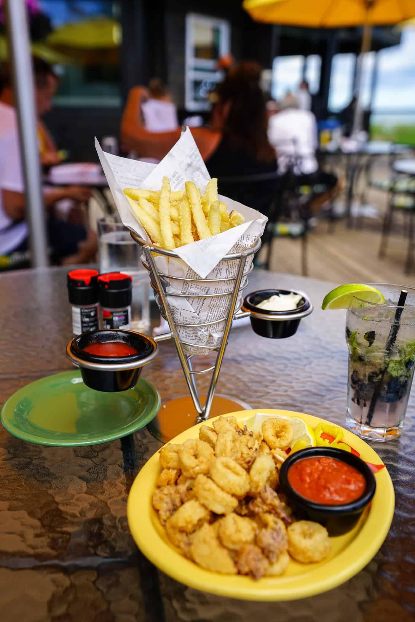Basket of fries and a plate of calamari