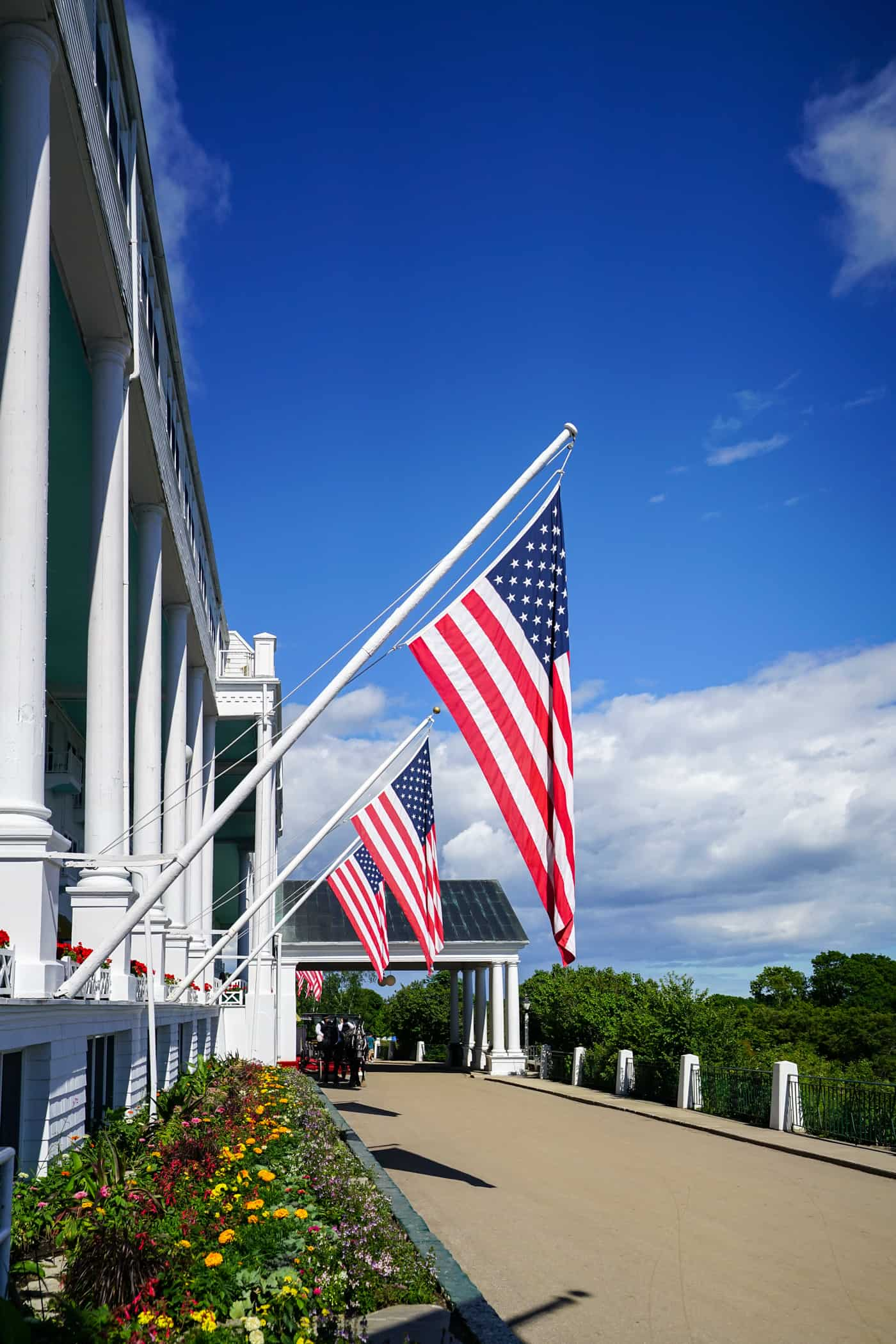 Three large American flags on the balcony of the Grand Hotel Mackinac Island