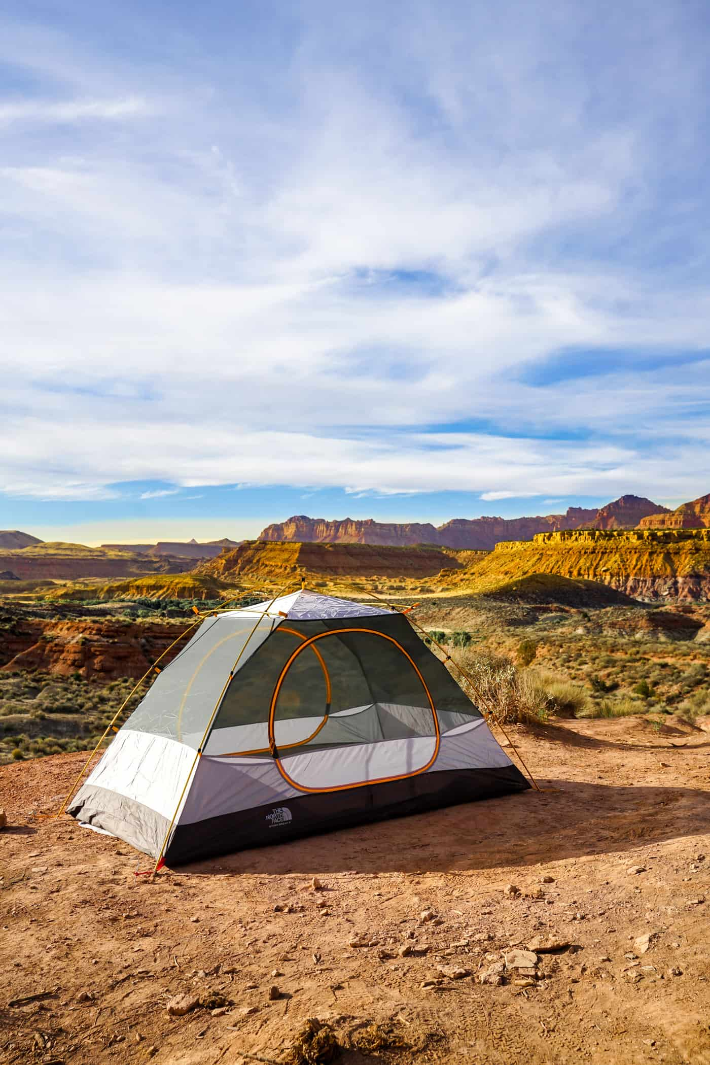 A North Face tent along the ridge of the red rocks in Utah.