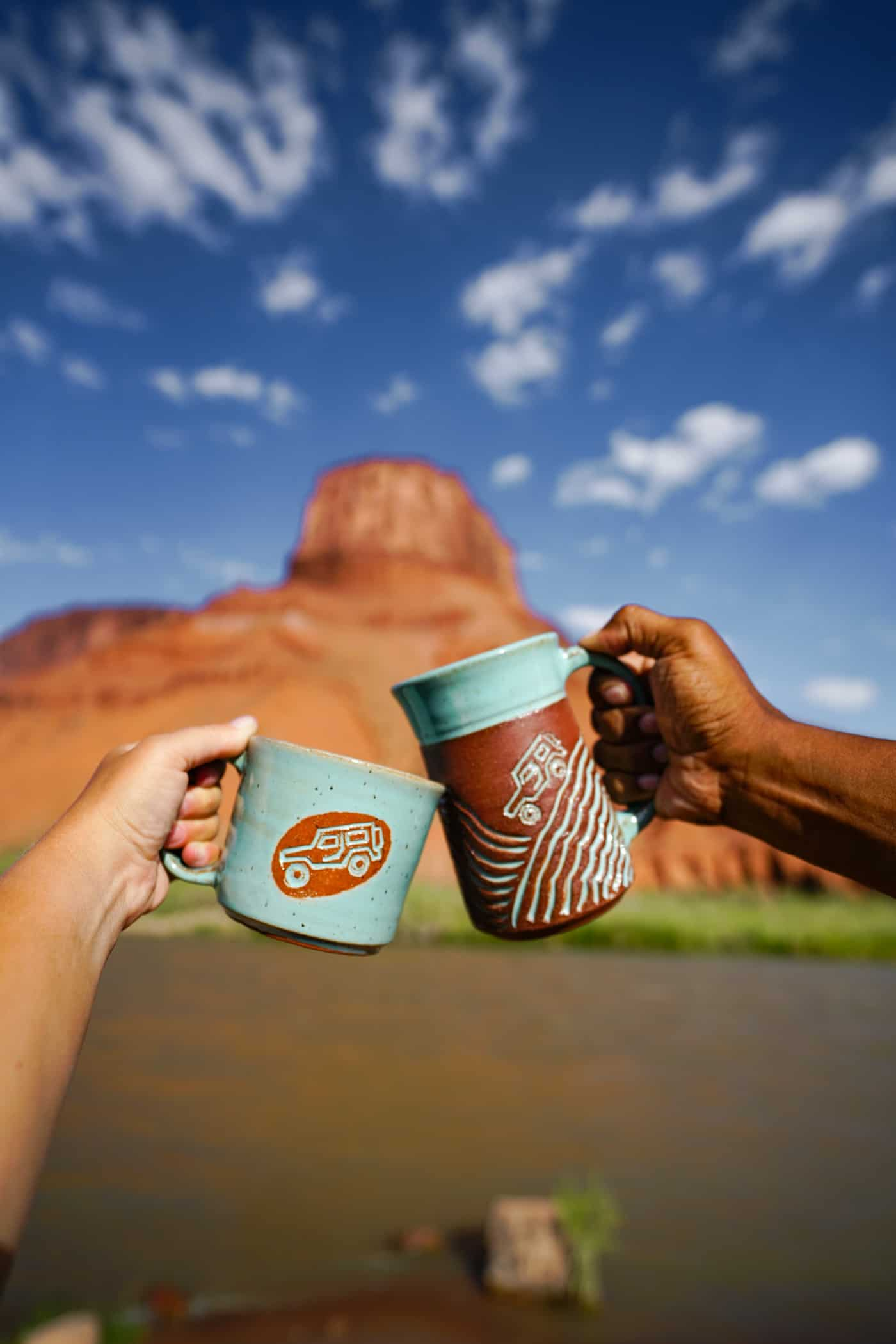 Two coffee mugs along the Colorado River in Moab, UT