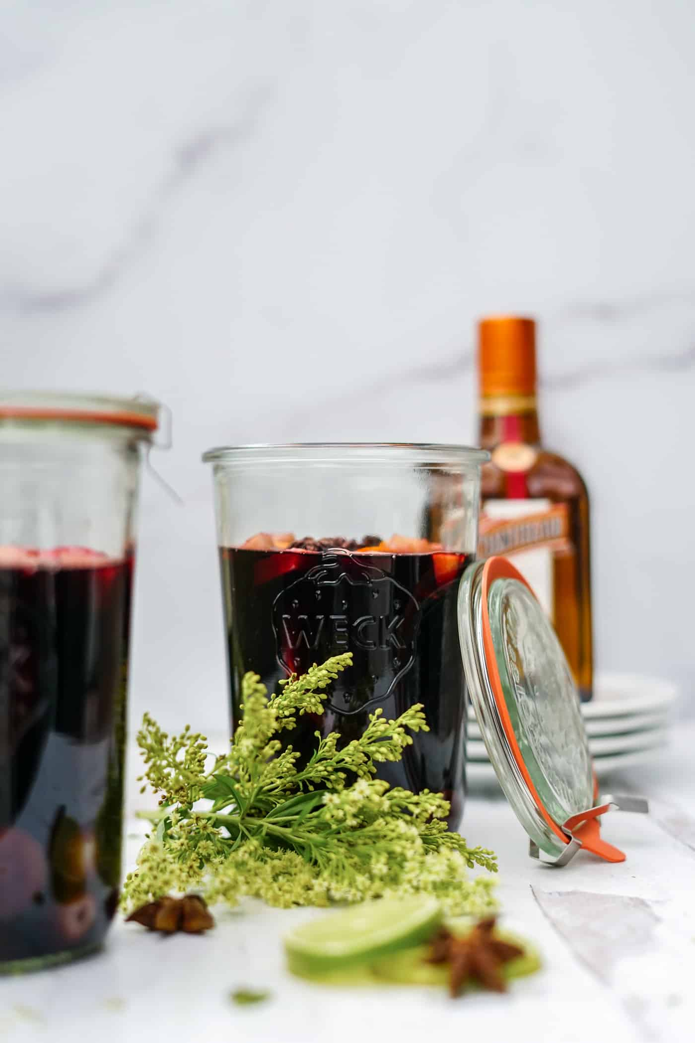 Mason jar sangria filled with red wine and fresh fruit.