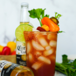 Large mason jar filled with a Mexican Michelada recipe