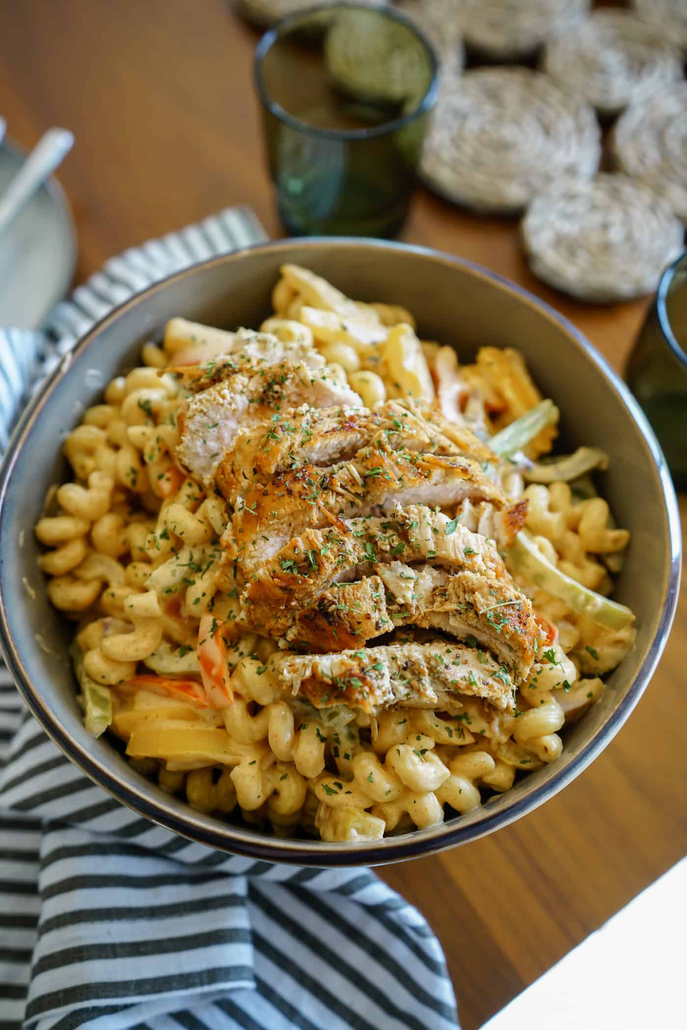 A large bowl of Instant Pot Chicken Fajita Pasta with bell peppers and onions.