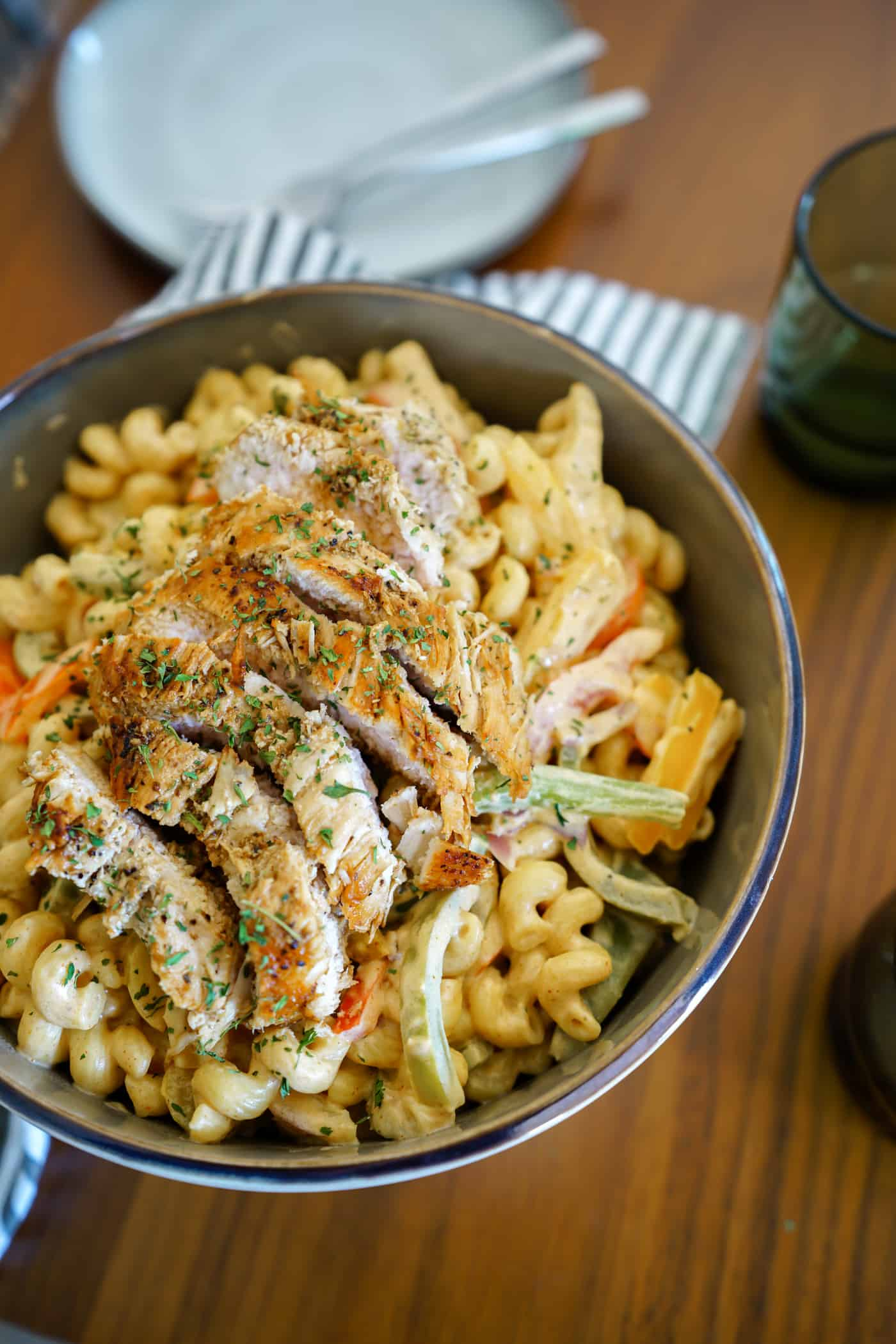 A large bowl of Instant Pot Chicken Fajita Pasta with bell pwppers and onions.